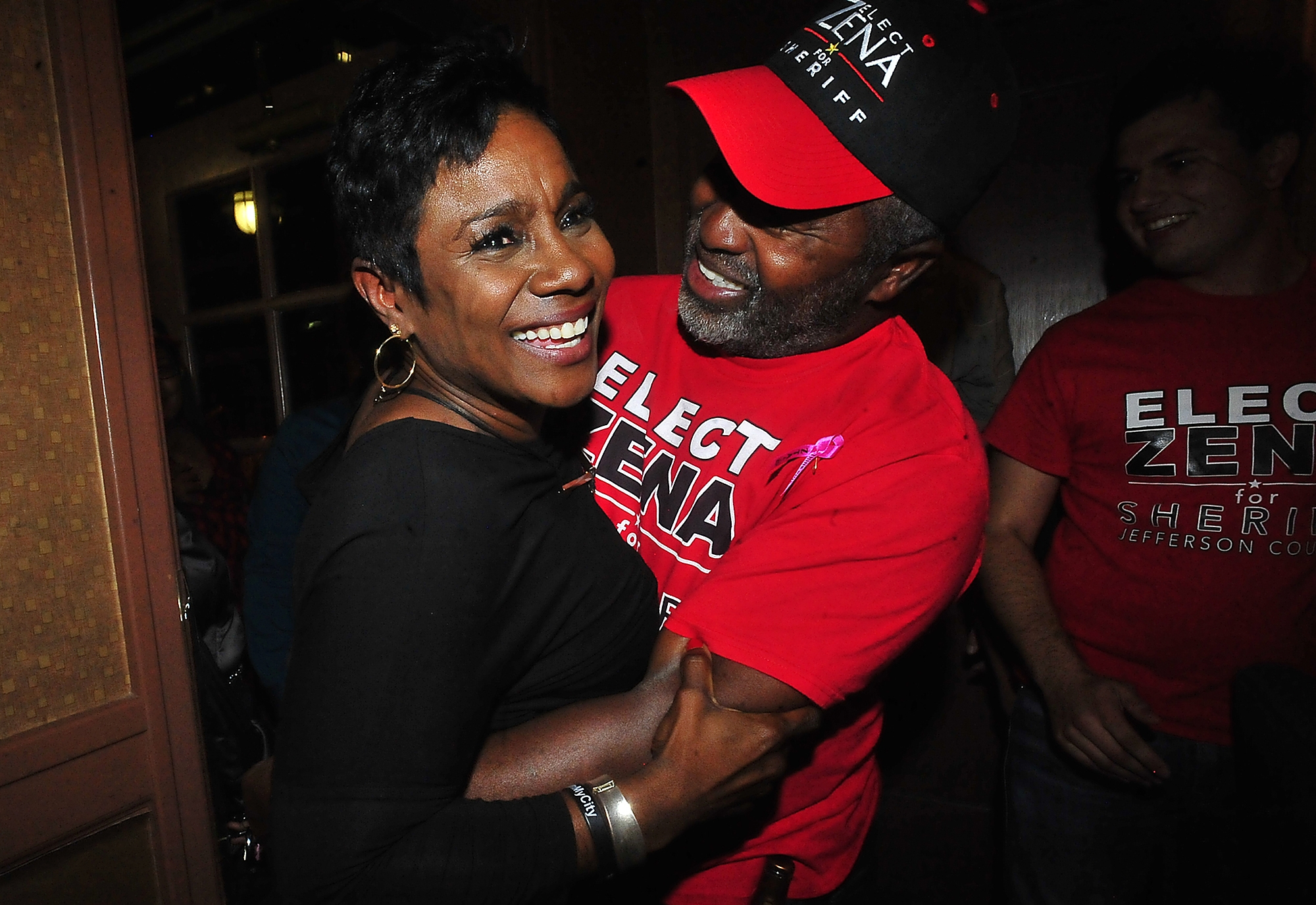 FILE - In this Nov. 8, 2016 file photo, Zena Stephens,is surrounded by supporters while celebrating her election win over Republican Ray Beck for sheriff in Beaumont, Texas on Tuesday, Nov. 8, 2016.  When Stephens takes office on Jan. 1, she will join Vanessa Crawford in Petersburg, Va., as the only black female sheriffs in the U.S., according to the National Sheriff's Association.  (Kim Brent/The Enterprise via AP)
