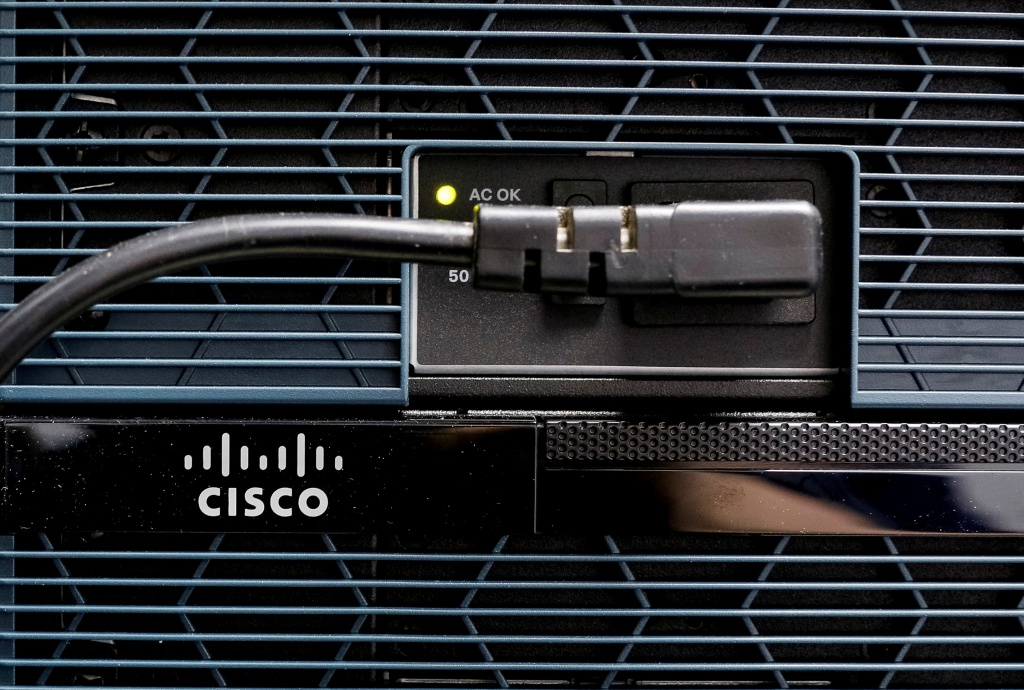 A Cisco logo is seen at the router in Kiev
