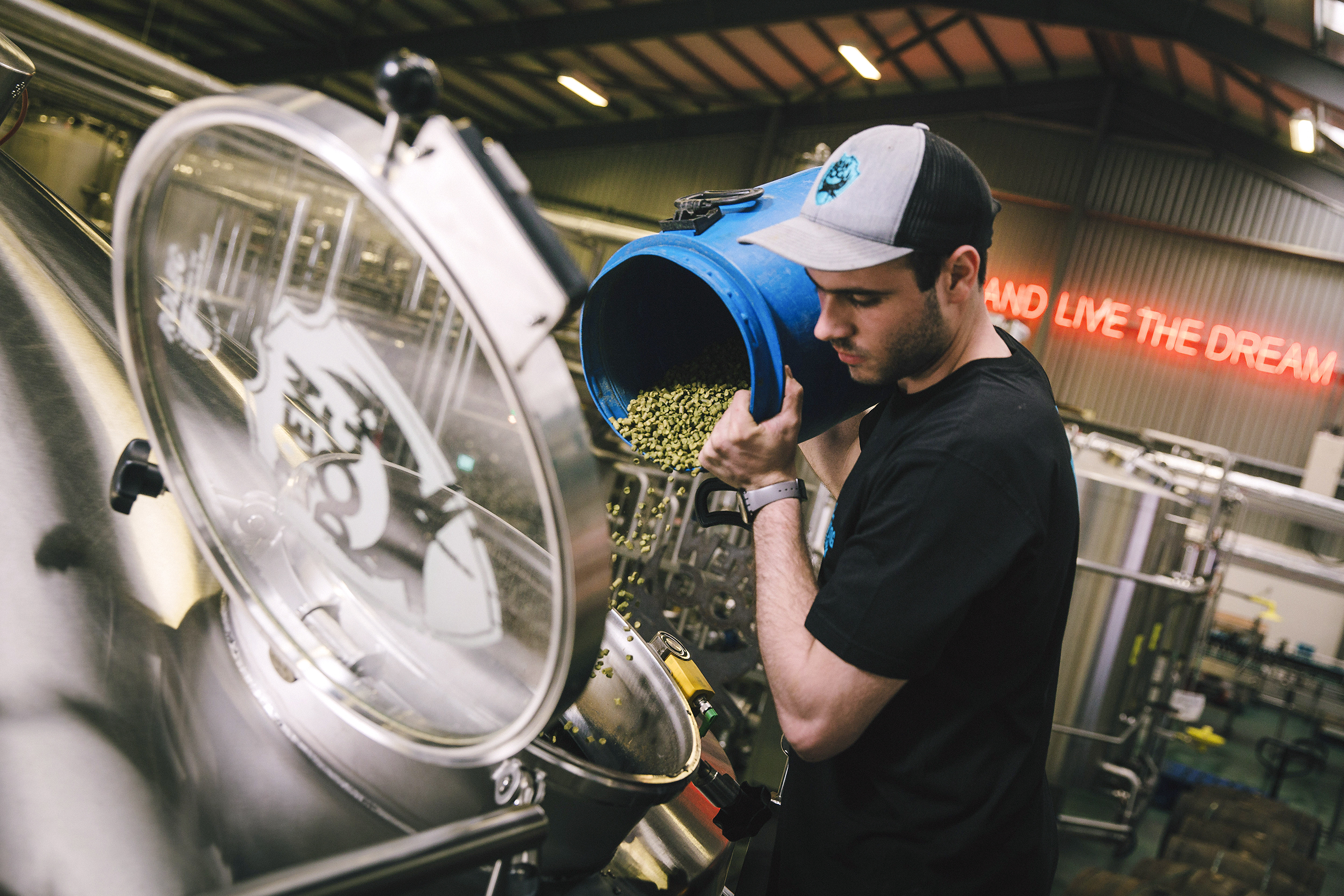 Pouring hops at the company's Scottish brewery.