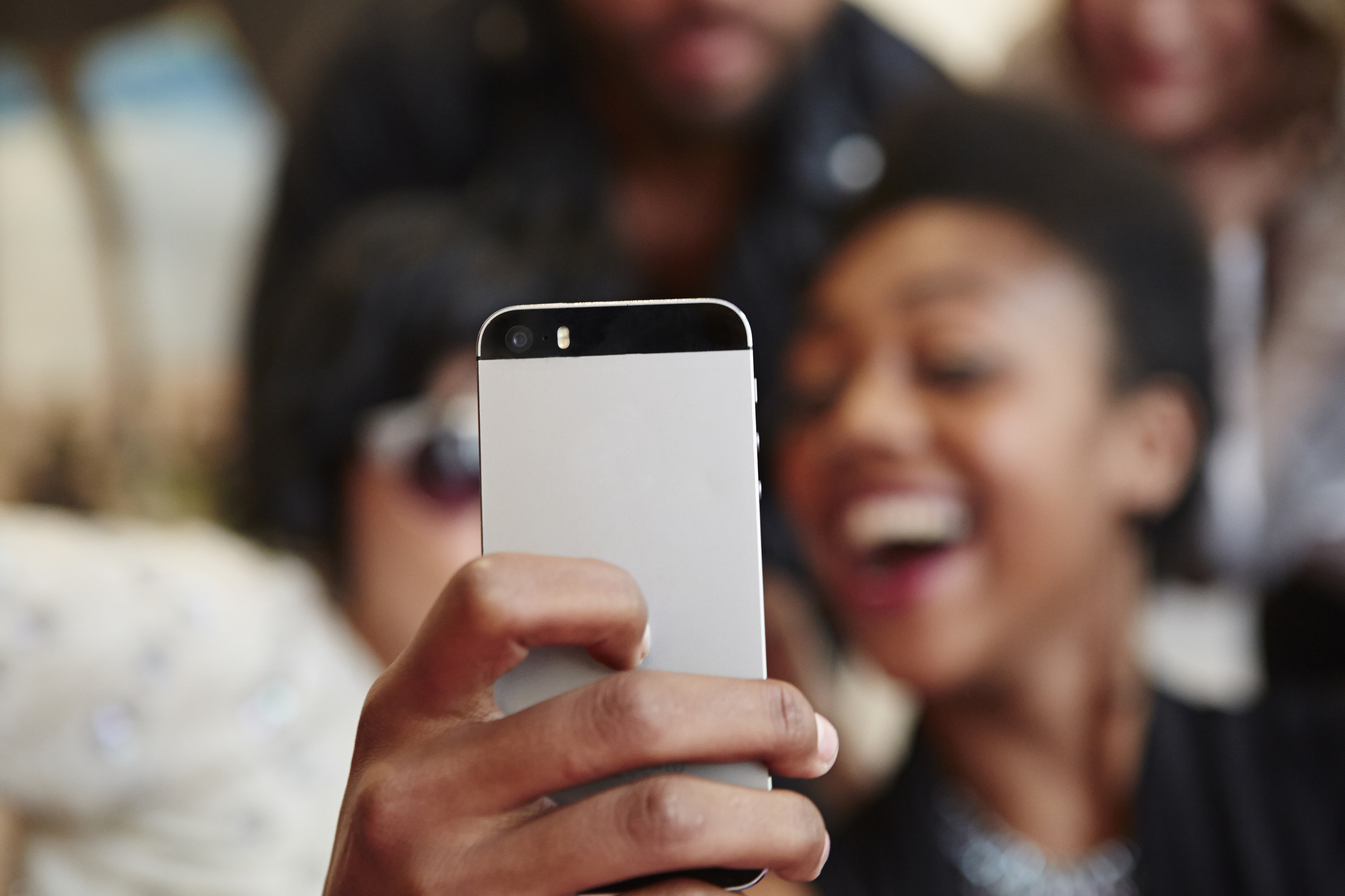 Group of friends taking a selfie with cell phone