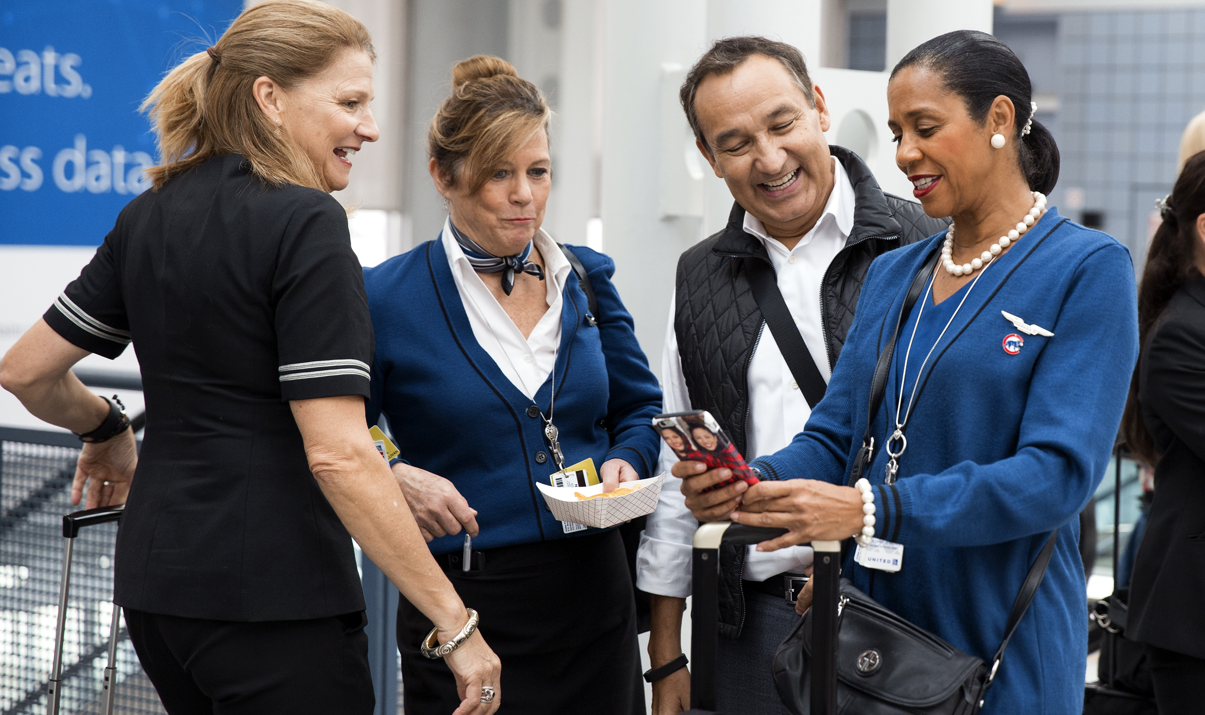 Munoz taking selfies with United employees at O'Hare Airport in Chicago. Earlier this year the CEO moved decisively to settle contract negotiations with the flight attendants' union, leading to better service and happier customers.
