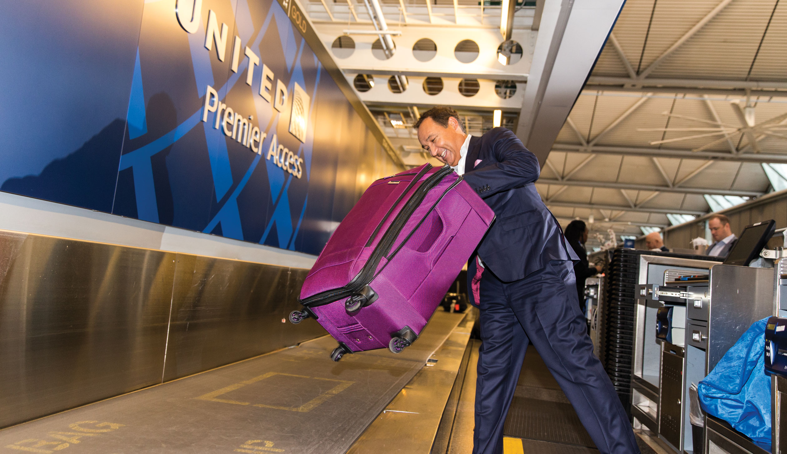 Munoz loads bags at United's check-in counter at O'hare.