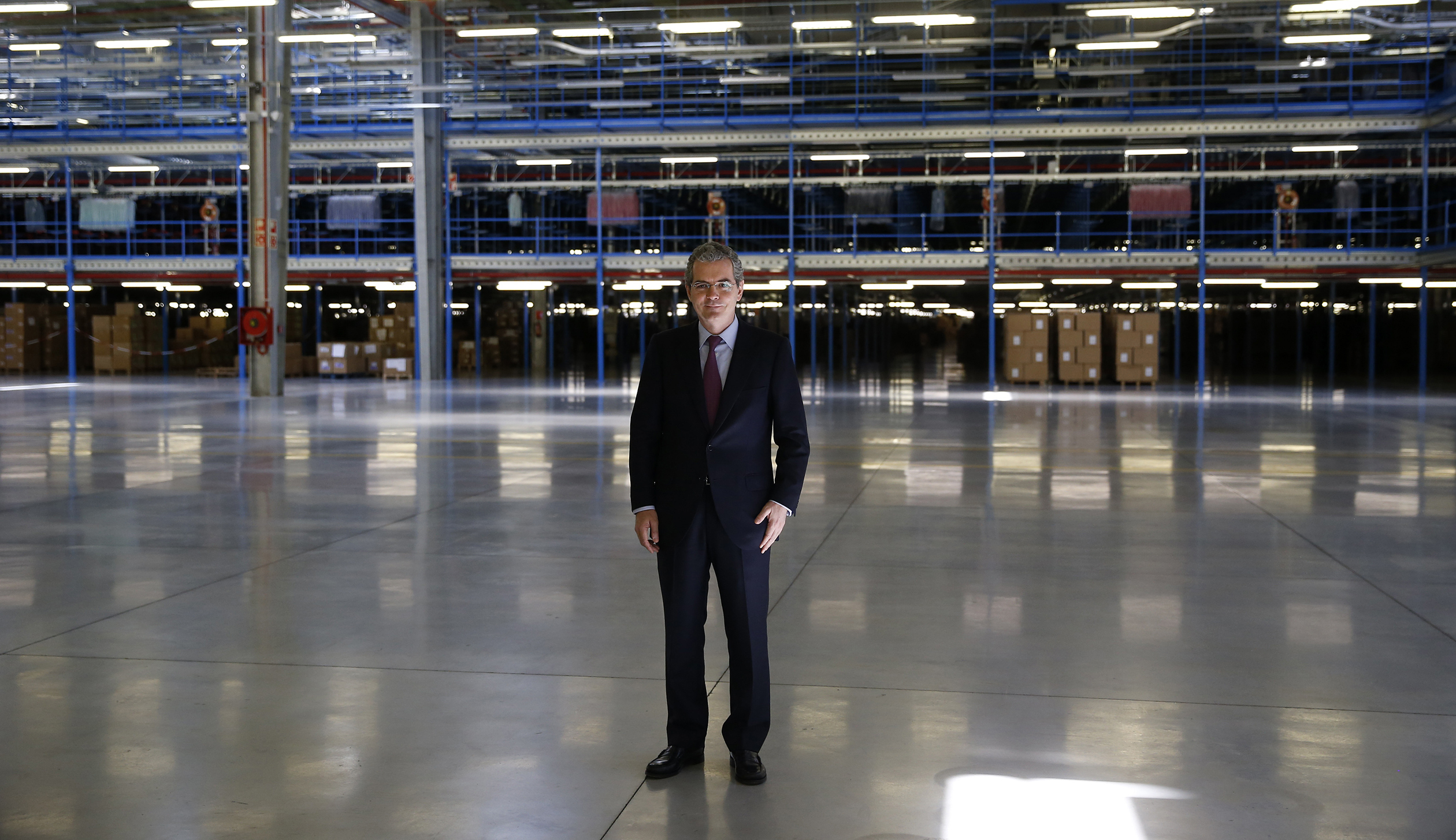Inditex Chairman and CEO Isla poses for a picture at a distribution center outside Meco