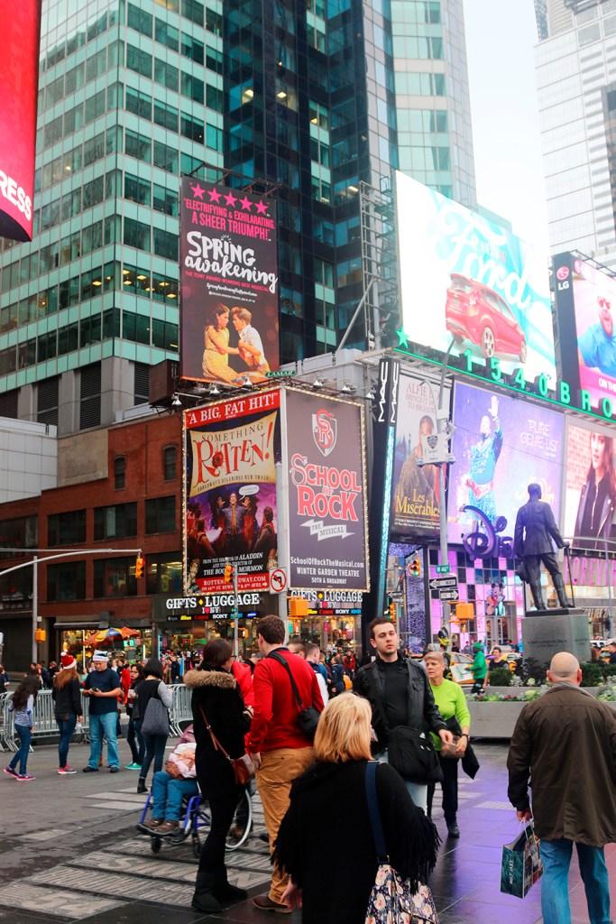 Pedestrians In Times Square