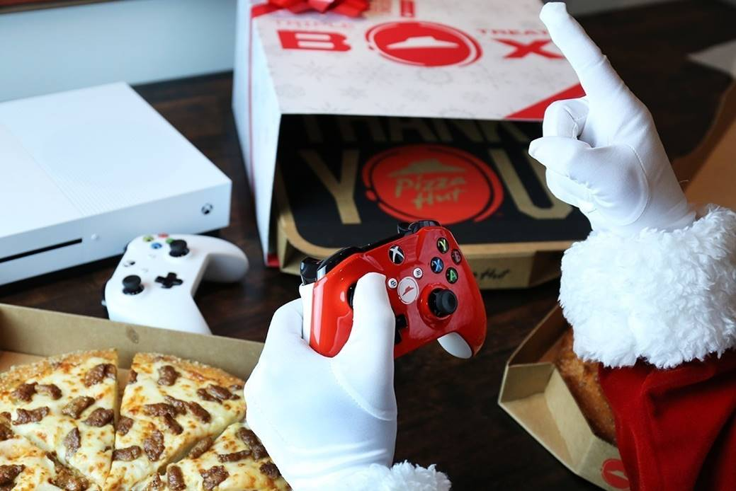 Xbox One S and a Pizza Hut Triple Treat box.
