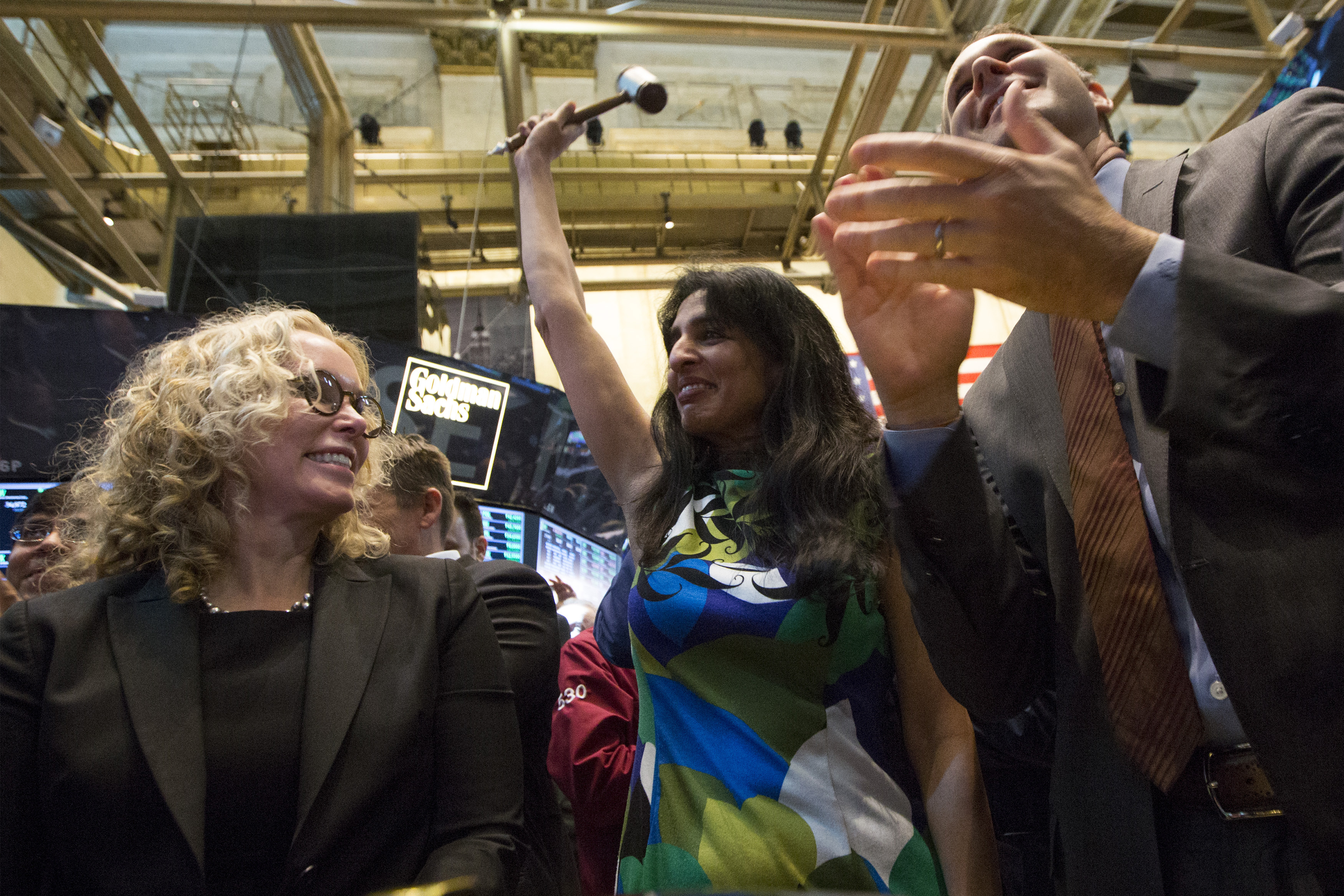 Ullal, president and CEO of Arista Networks, raises a gavel after her company's stock began trading during its IPO on the floor of the New York Stock Exchange