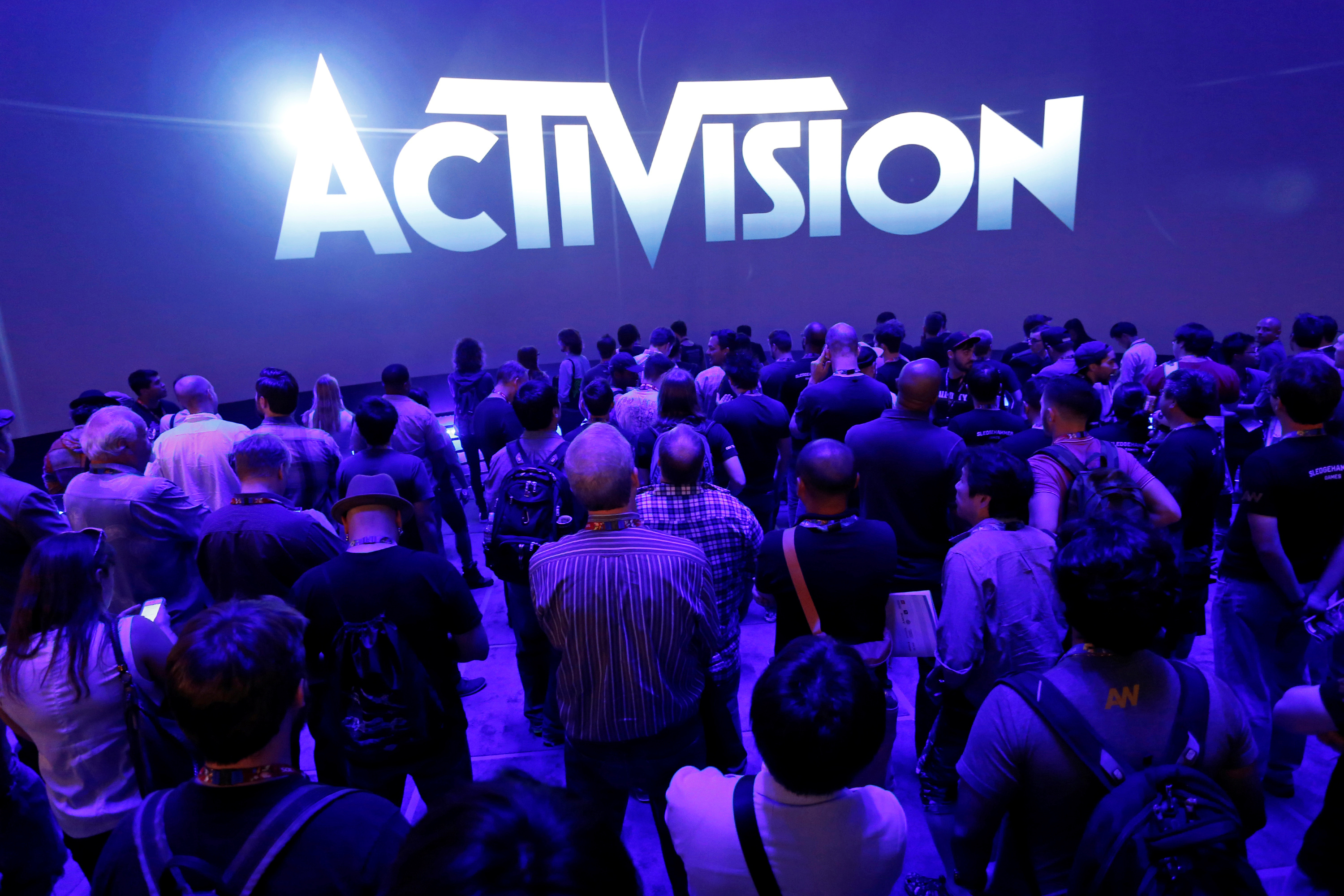 Crowd waits for video presentation at the Activision booth during the 2014 Electronic Entertainment Expo, known as E3, in Los Angeles