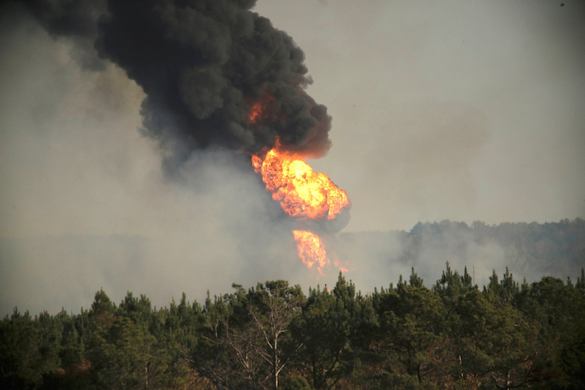 Flames shoot into the sky from a gas line explosion in western Shelby County