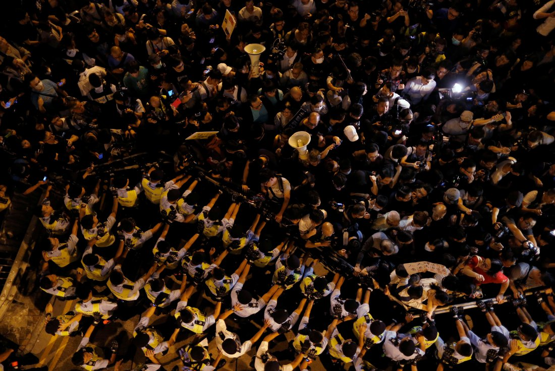 Police stop demonstrators as they protest in Hong Kong