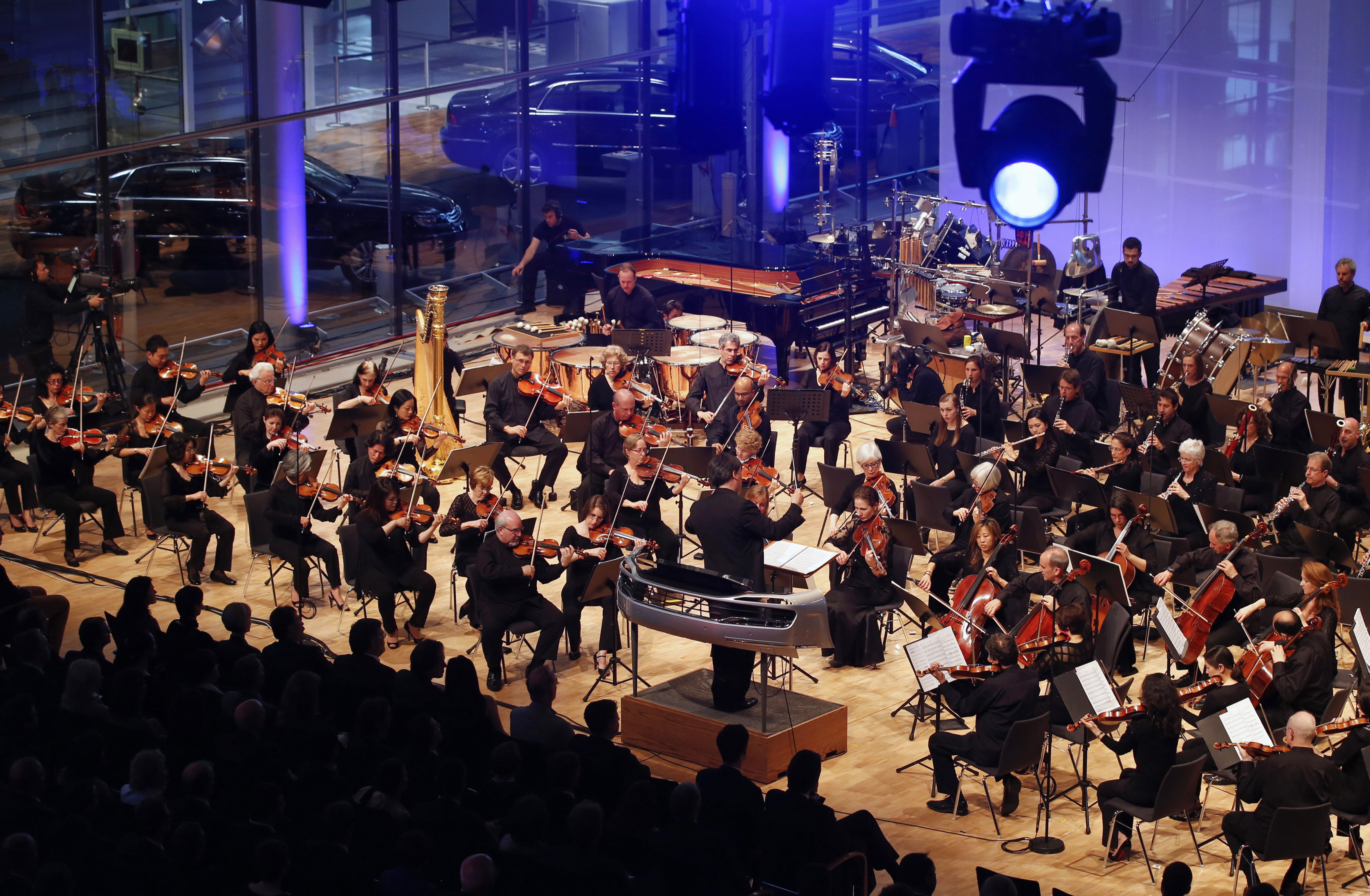 Gilbert, chief conductor of New York Philharmonic, leads a performance of the composition 'Kraft' inside the Glaeserne Manufaktur in Dresden