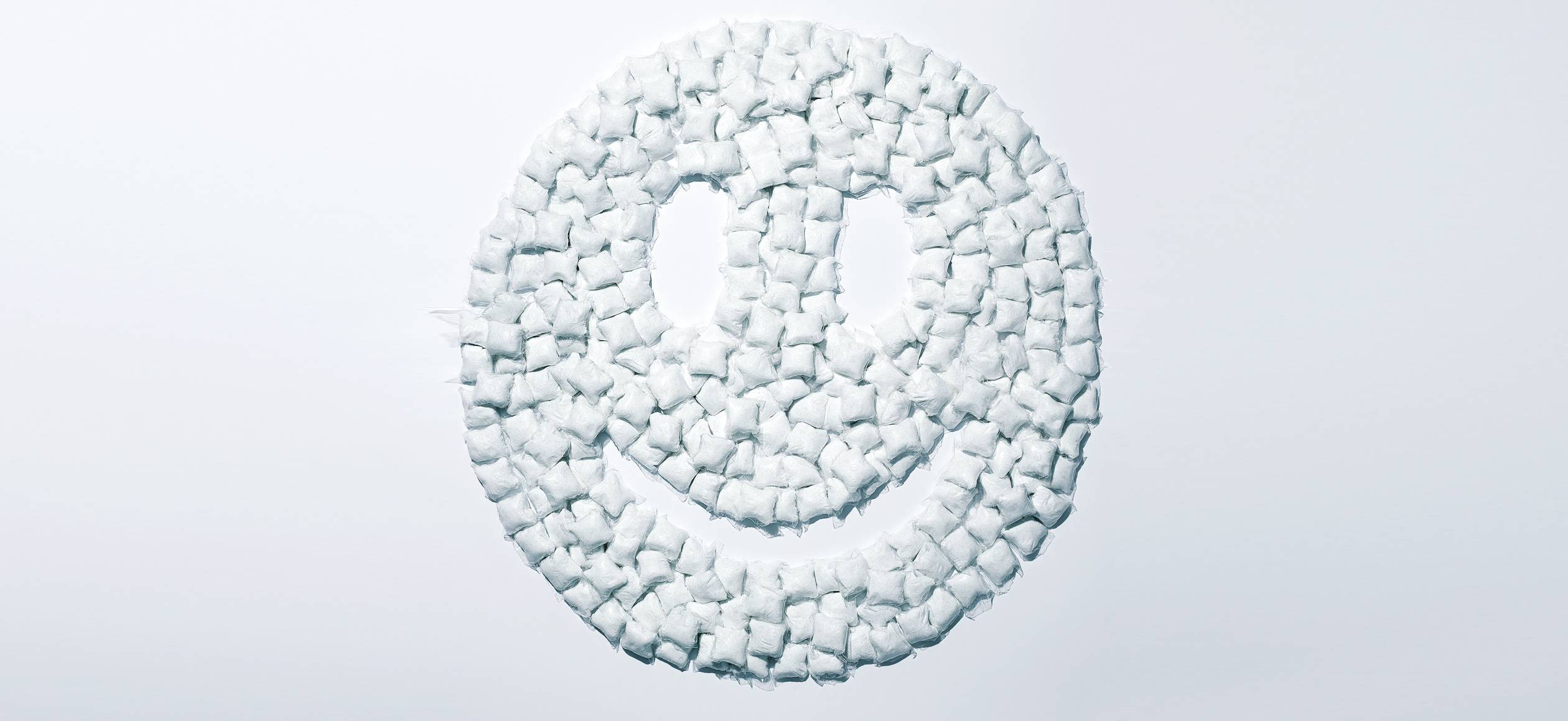 A happy face made of Seventh Generation laundry detergent packs
