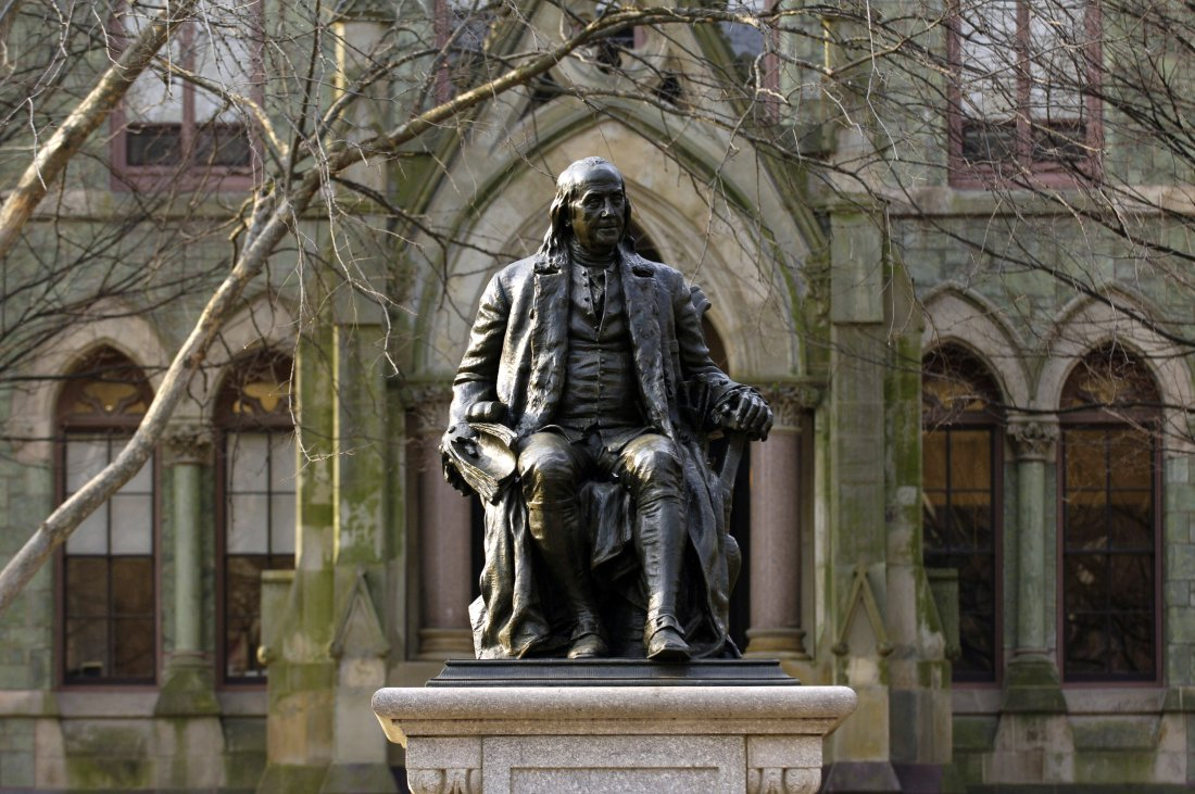 A statue of Benjamin Franklin, founder of the University of