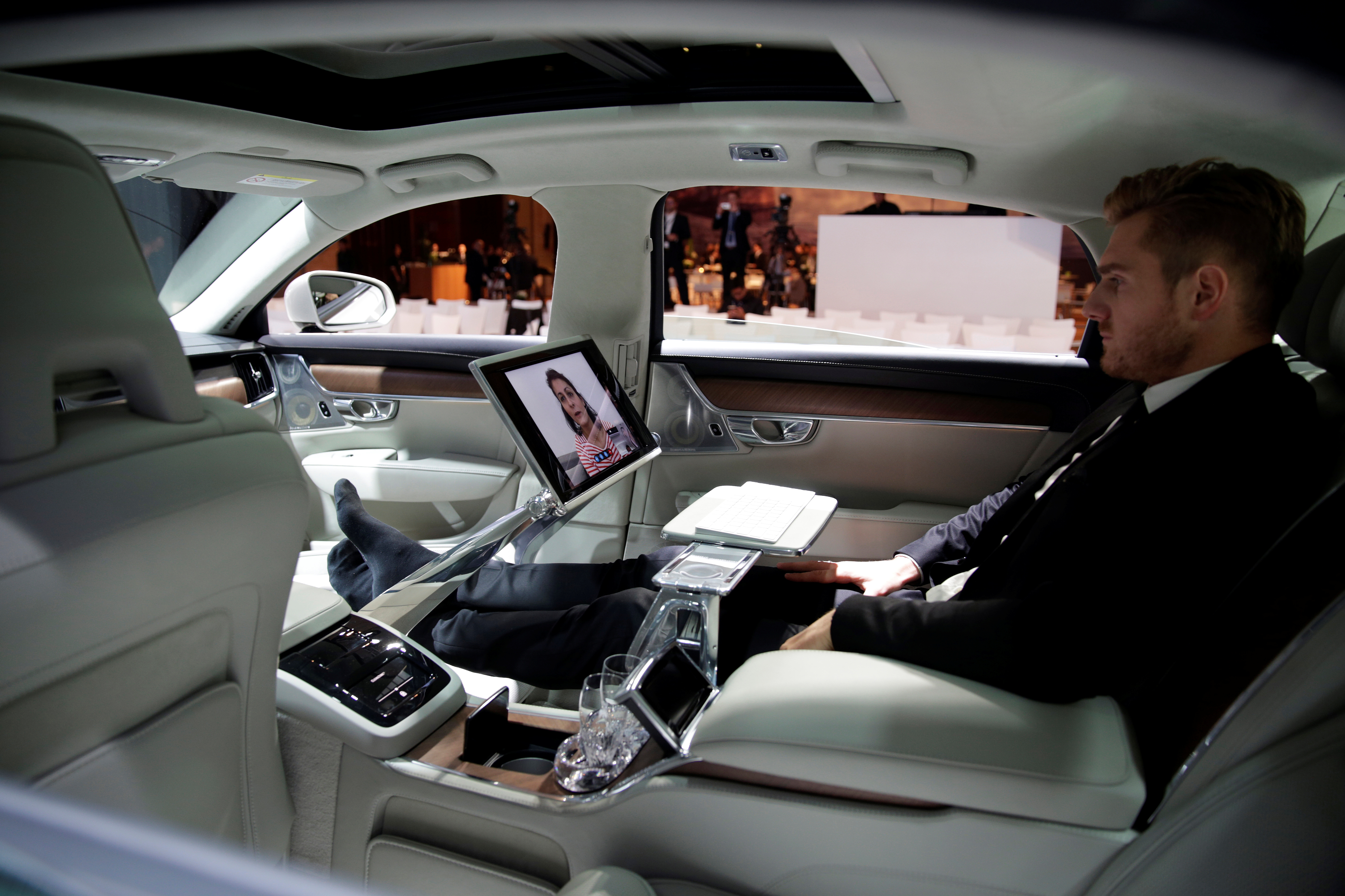 An attendee sits in Volvo's S90 car during the company's news conference in Shanghai