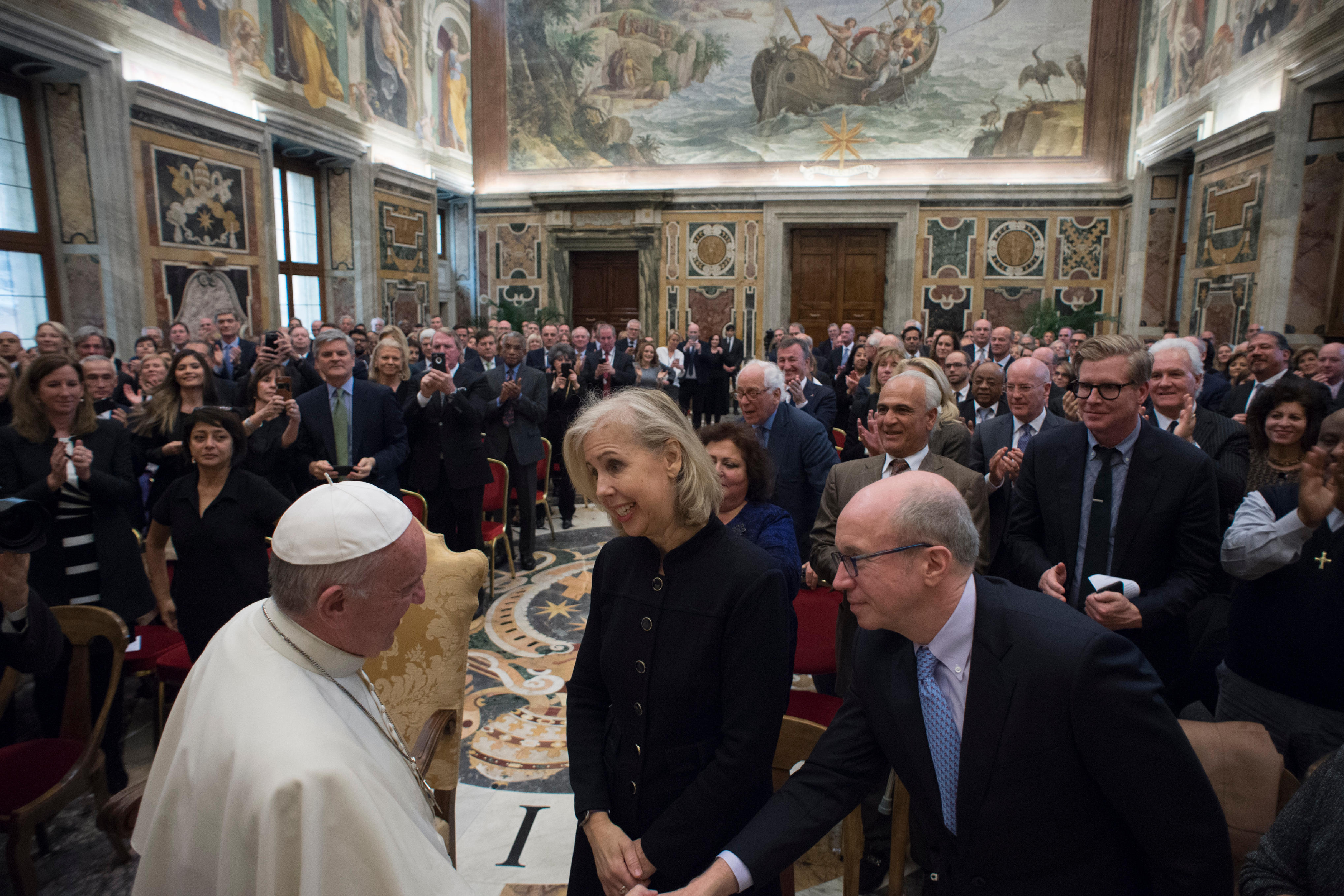 Pope Francis greets Time editor-in-chief Nancy Gibbs and Fortune's Alan Murray in December.