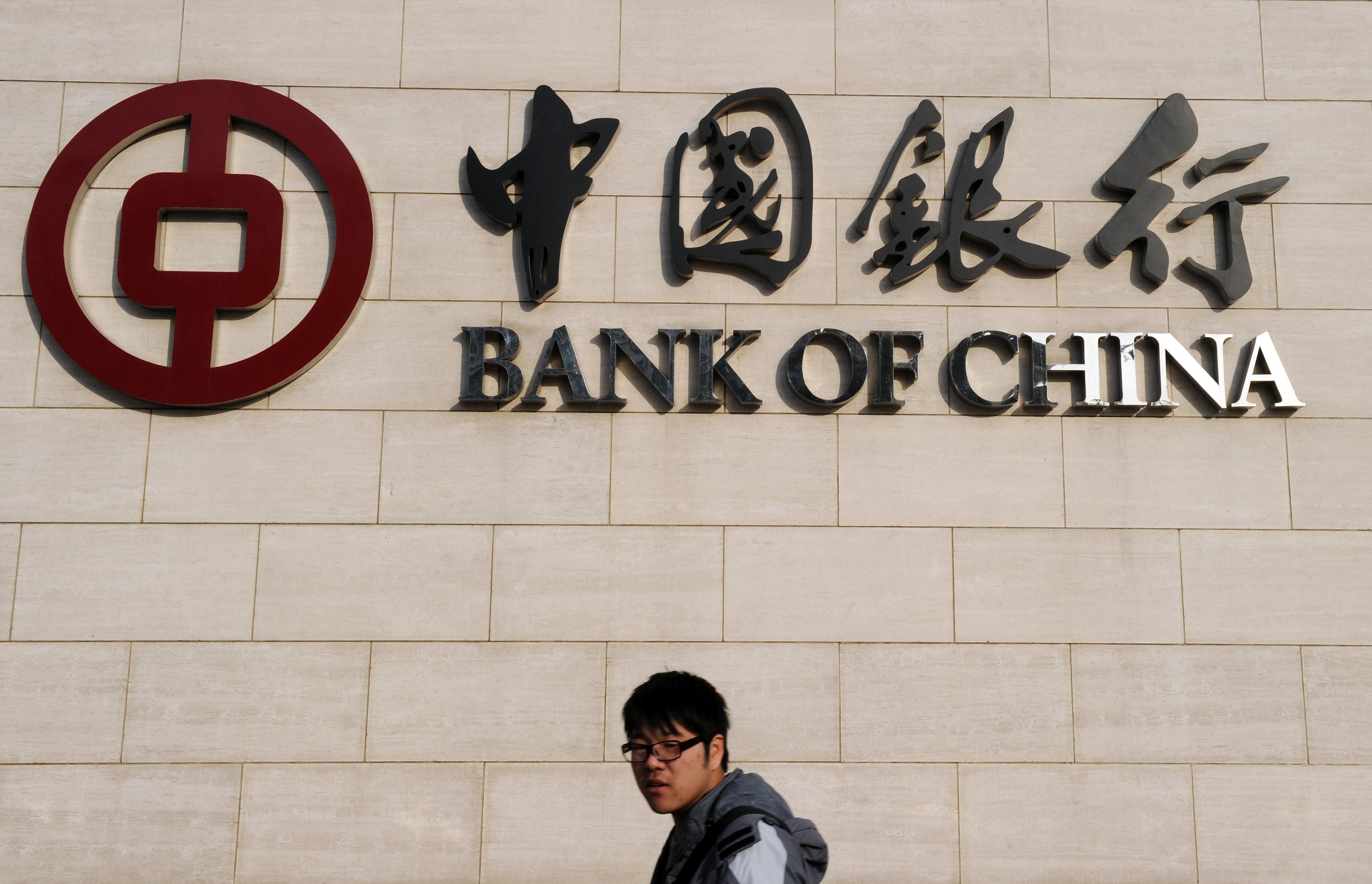 A man walks past the Bank of China headq