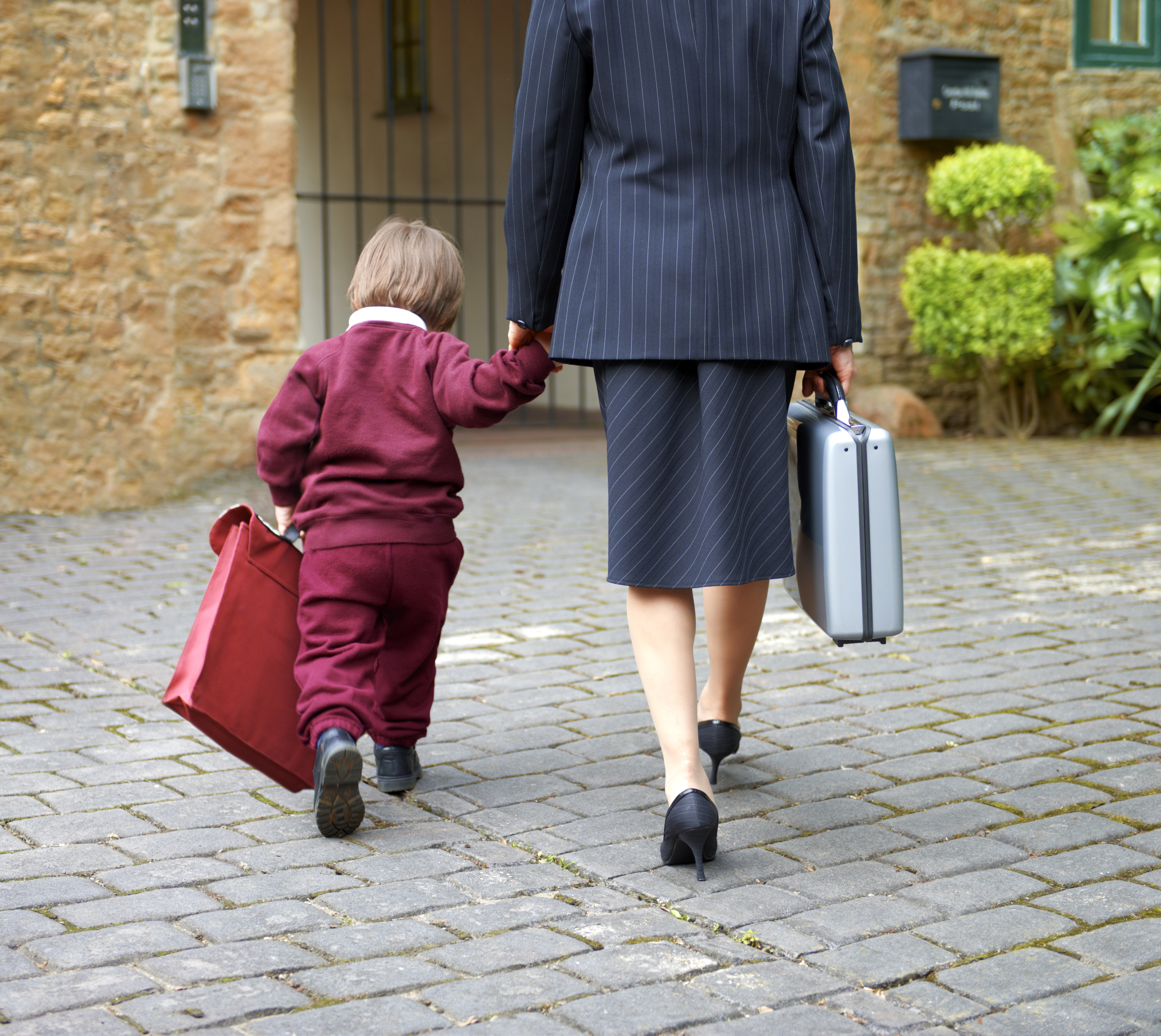 Single working mother taking child to school