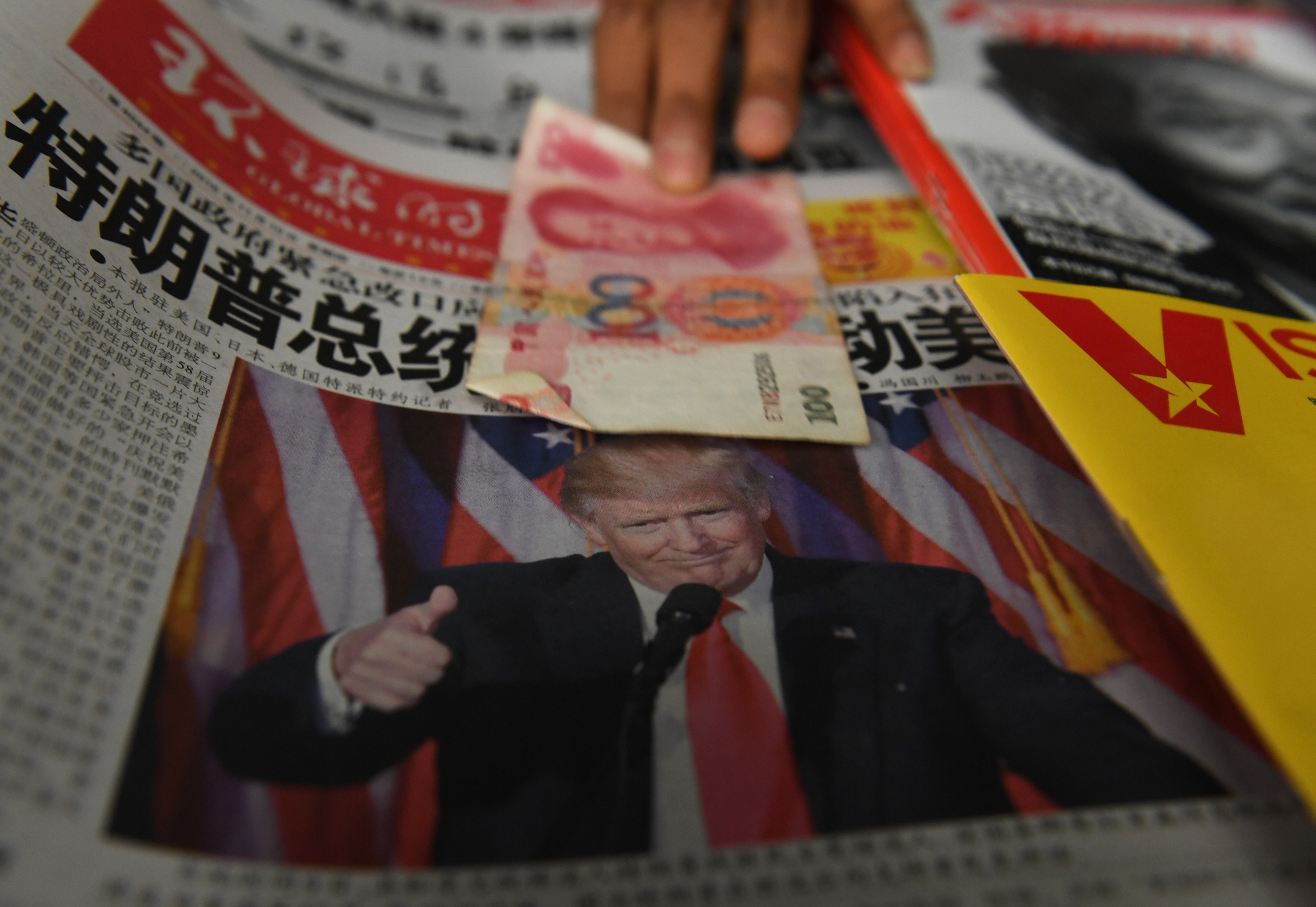 TOPSHOT-CHINA-US-VOTE-TRUMP-ECONOMY
