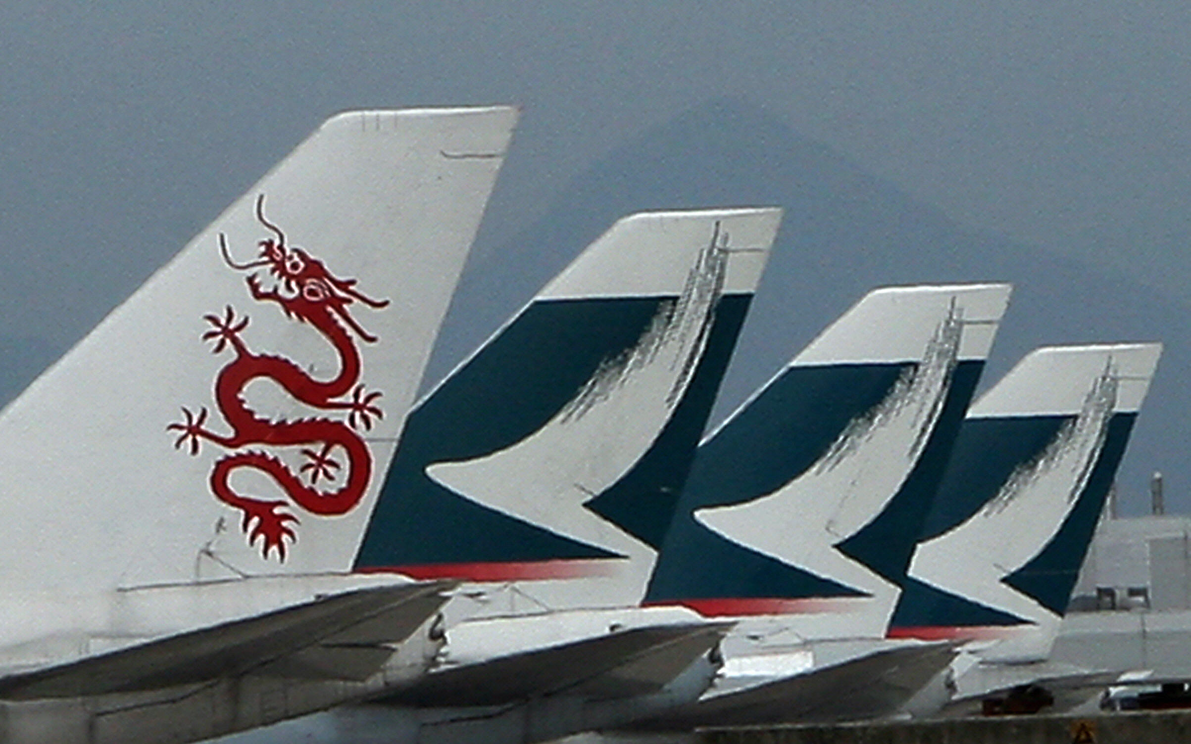 Dragon air (L) and Cathay Pacific planes