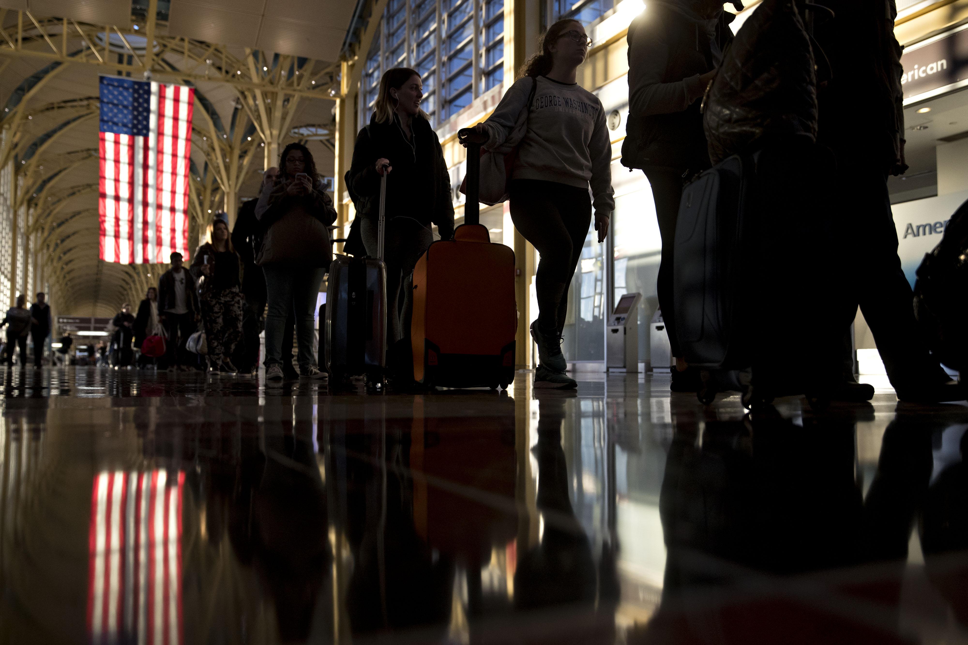 Travelers At Ronald Reagan Airport Ahead Of Thanksgiving Holiday