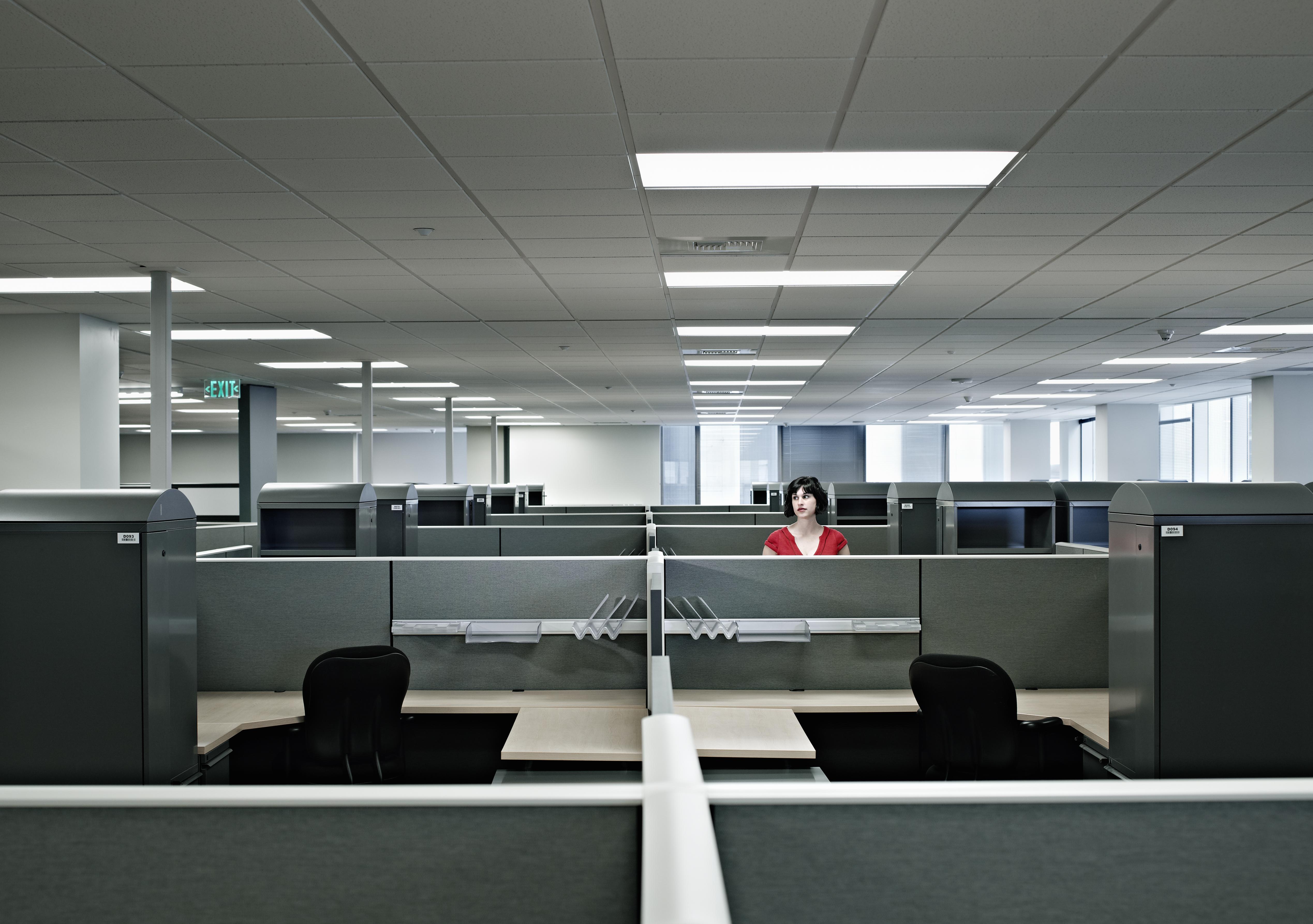 Businesswoman standing alone in empty office
