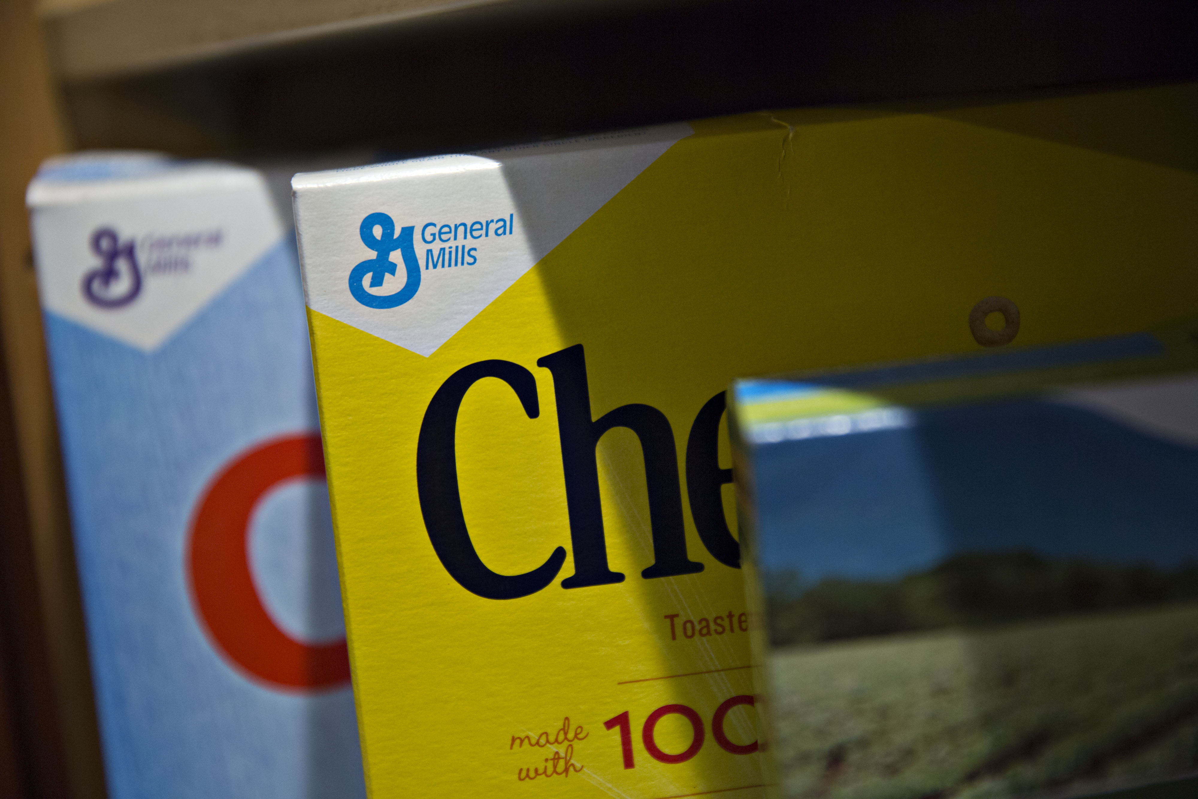 General Mills Inc. logos appear on boxes of Cheerios and Rice Chex brand cereal arranged for a photograph in Tiskilwa, Illinois, U.S., on Tuesday, Sept. 20, 2016.