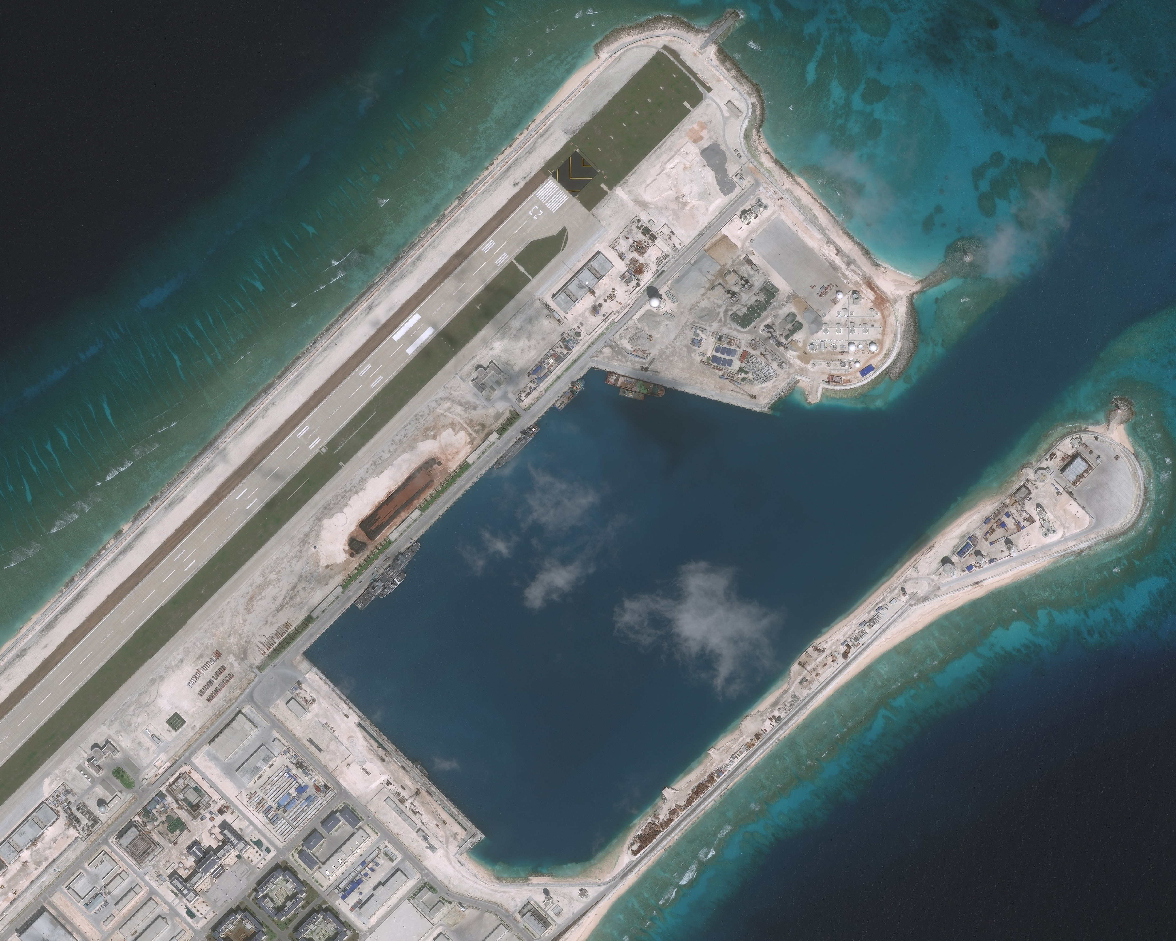 NOV 10, 2016: DigitalGlobe imagery (closeup-2) of the Fiery Cross Reef located in the South China Sea. Fiery Cross is located in the western part of the Spratly Islands group.