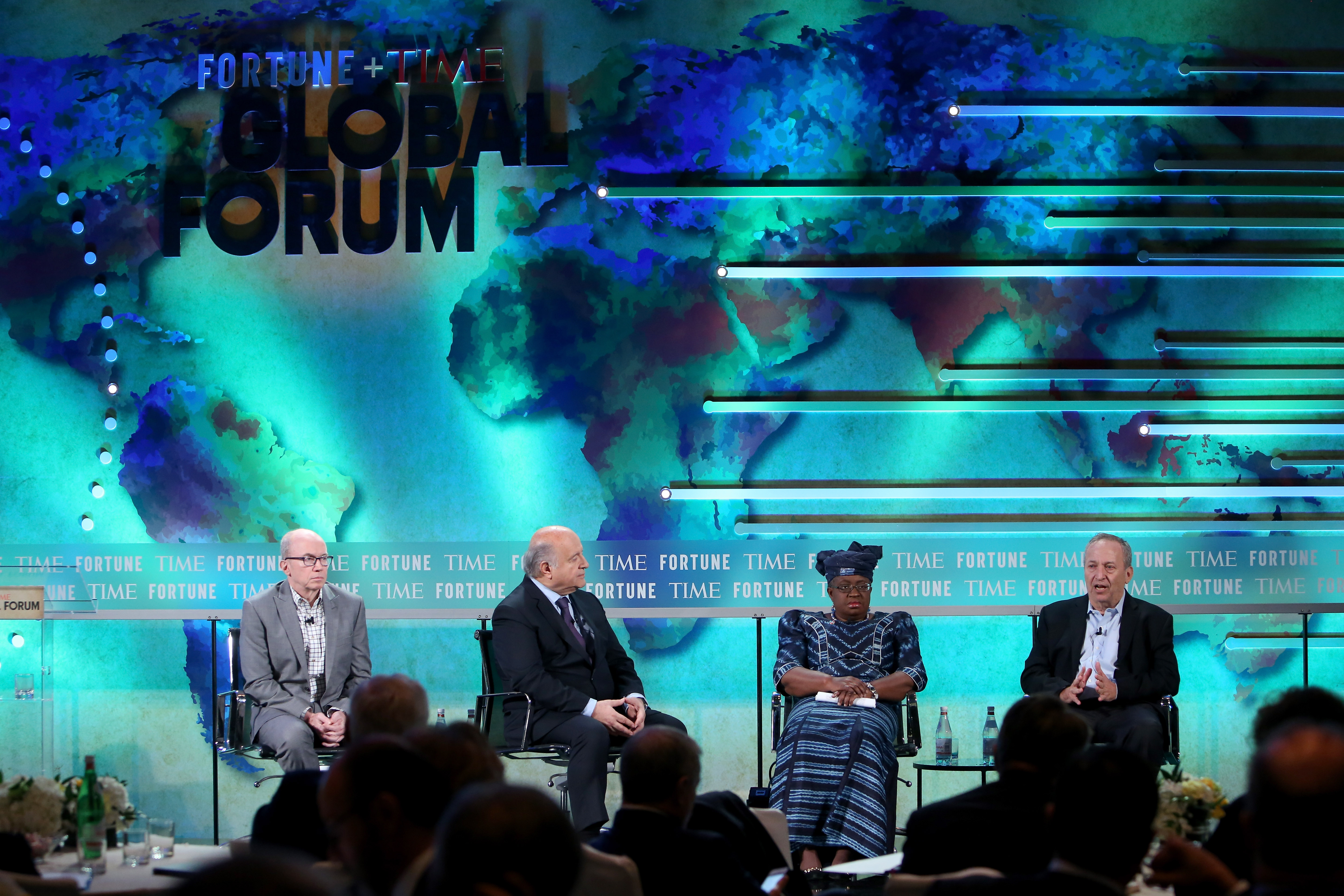 ROME, ITALY - DECEMBER 02:  (L-R) Alan Murray, Editor-in-Chief of Fortune and Chief Content Officer, Hernando de Soto, President of Institute for Liberty and Democracy, Ngozi Okonjo-Iweala, Chair, Gavi, the Global Alliance for Vaccines and Immunization, and Lawrence Summers, Harvard University President Emeritus, speak at the Fortune + Time Global Forum 2016 on December 2, 2016 in Rome, Italy.  (Photo by Elisabetta Villa/Getty Images for TIME)