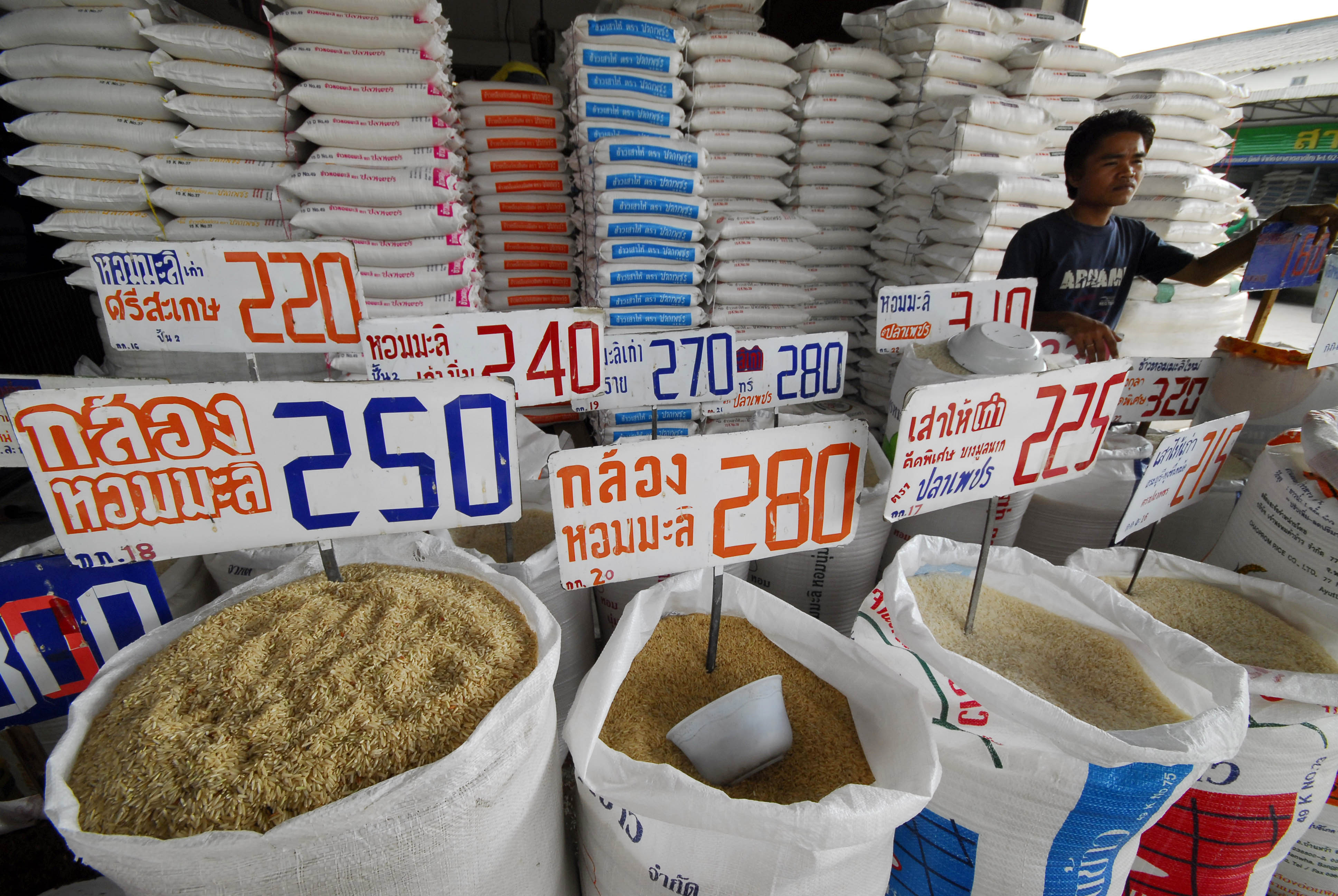 A vendor sells rice at at a shop in a produce market in Nawa