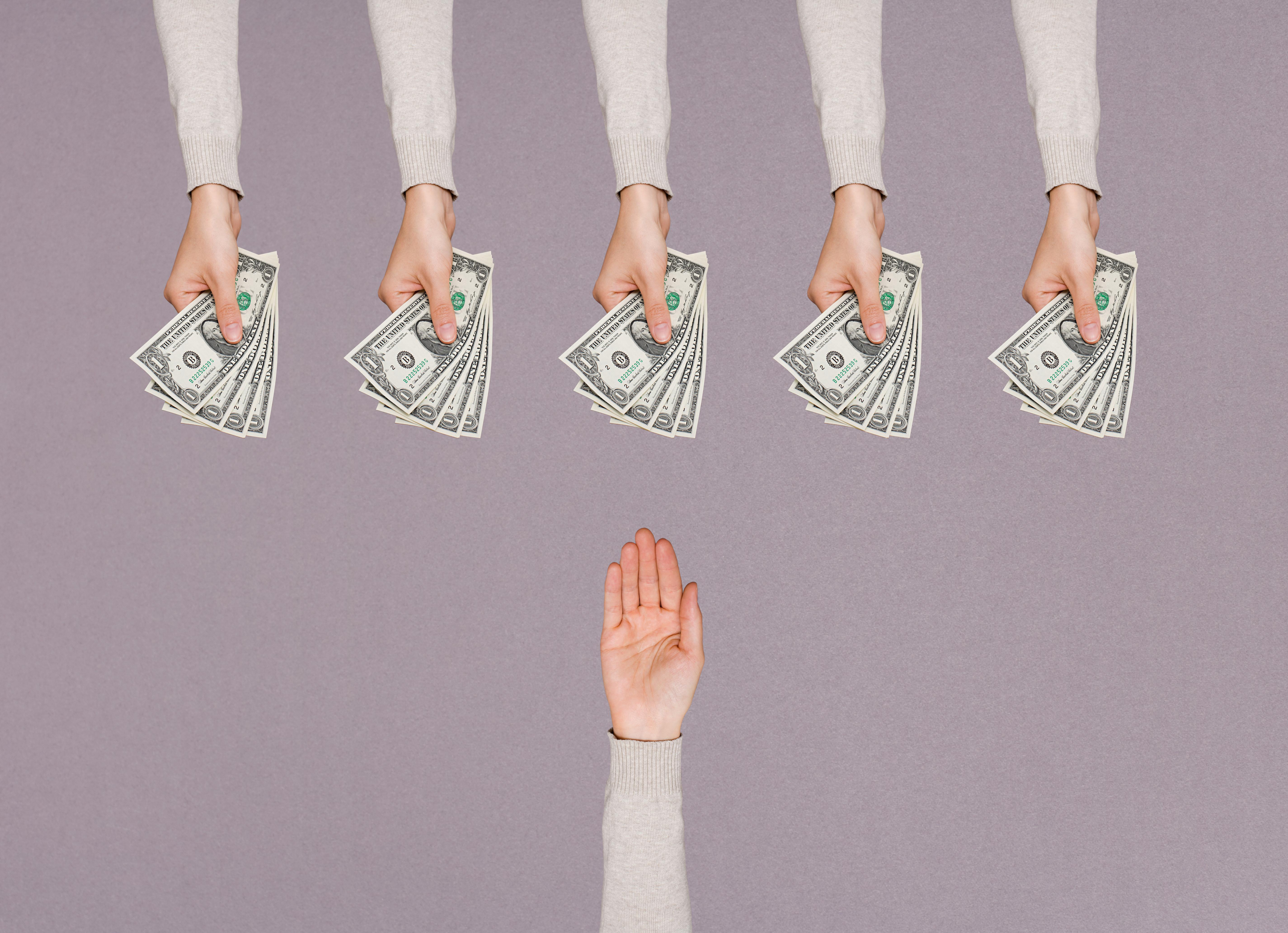 People handing over money