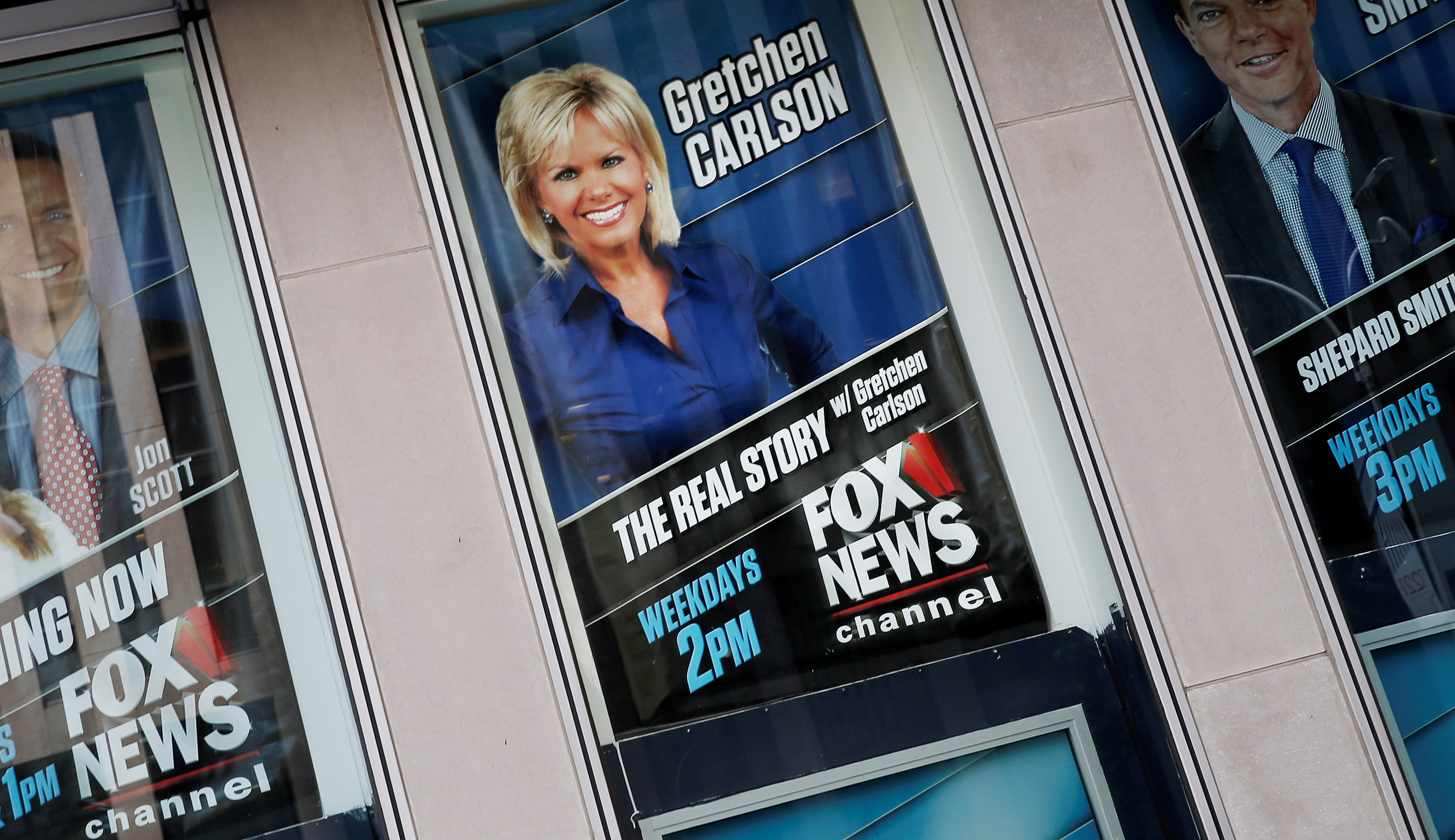 Posters of Fox News personalities including Gretchen Carlson are seen at the News Corporation headquarters building in New York