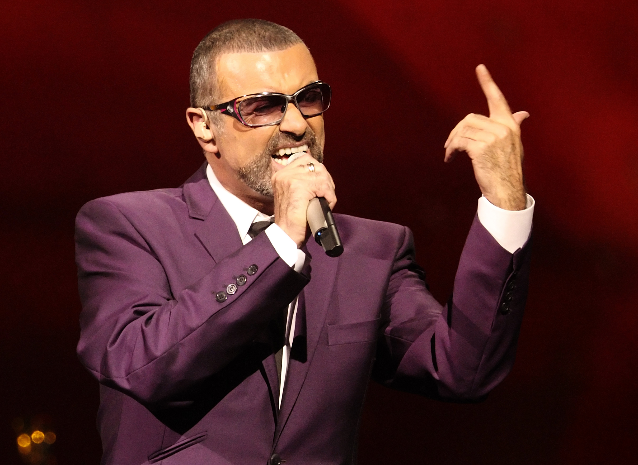 """British singer George Michael performs on stage during his """"Symphonica"""" tour concert in Vienna"""