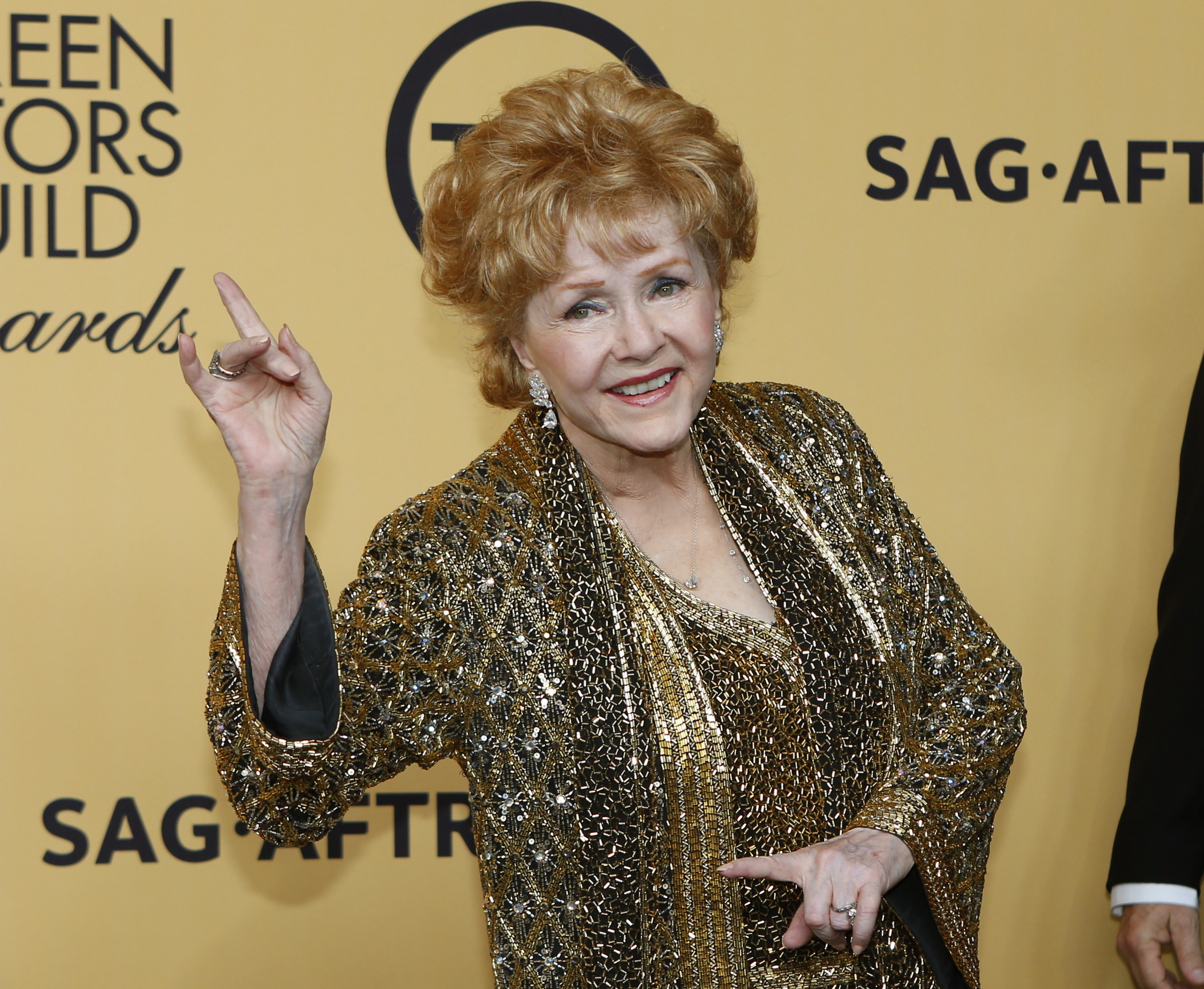 Actress Debbie Reynolds poses backstage after accepting her Lifetime Achievement awards at the 21st annual Screen Actors Guild Awards in Los Angeles