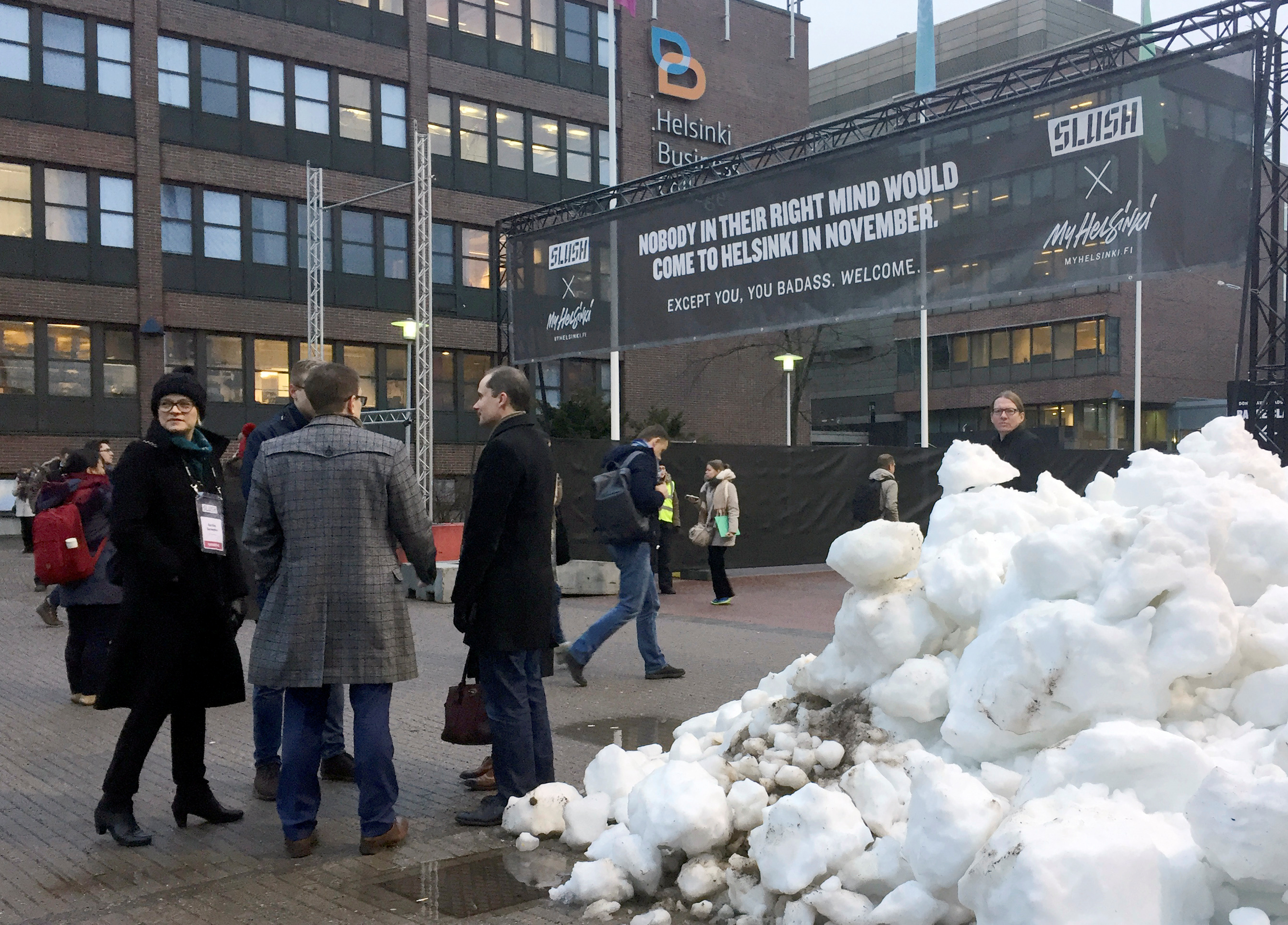 People gather near the entrance to the venue of Slush, one of Europe's biggest tech start-up conferences in Helsinki