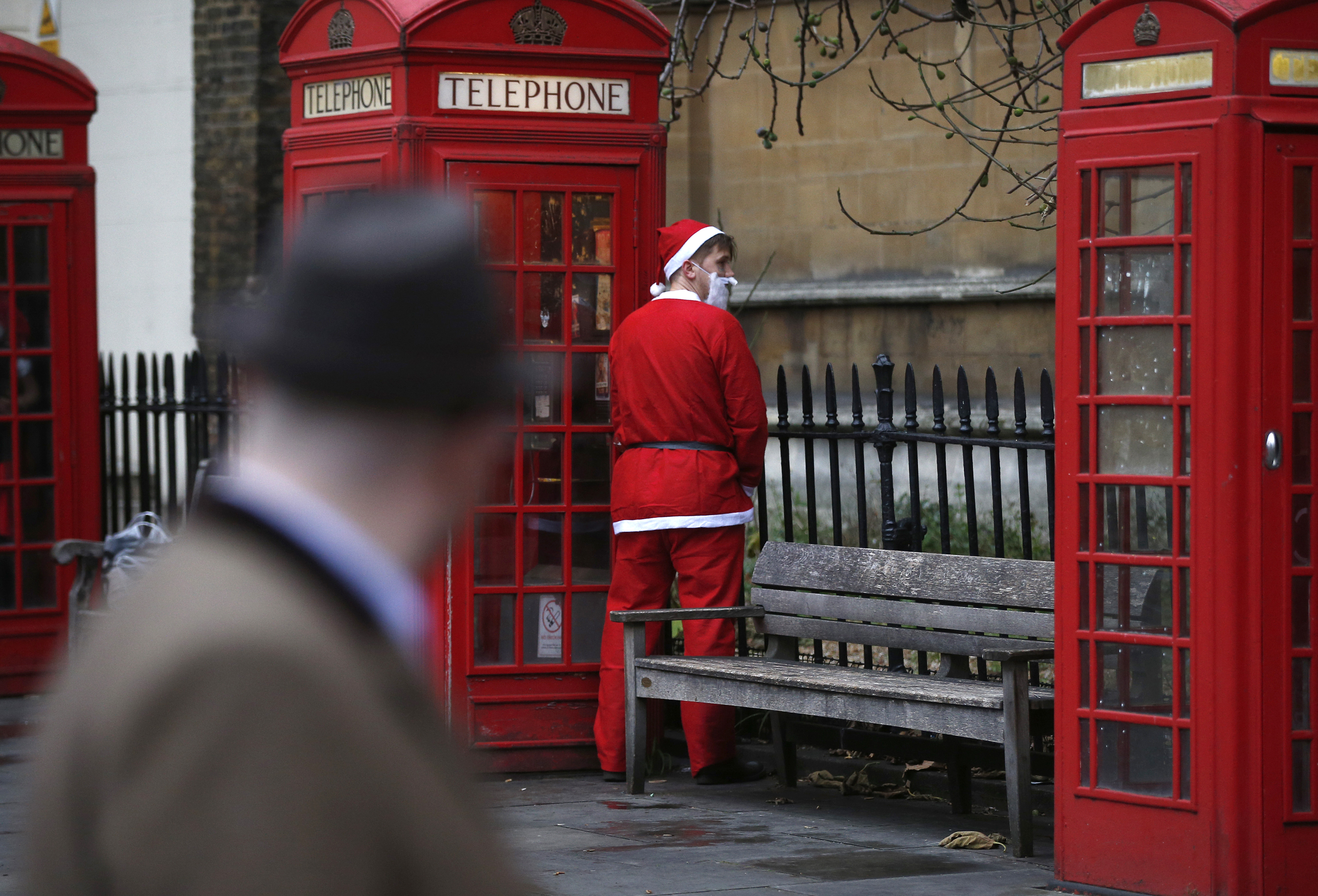 A man dressed as Santa Claus relieves himself during the Santacon event in London