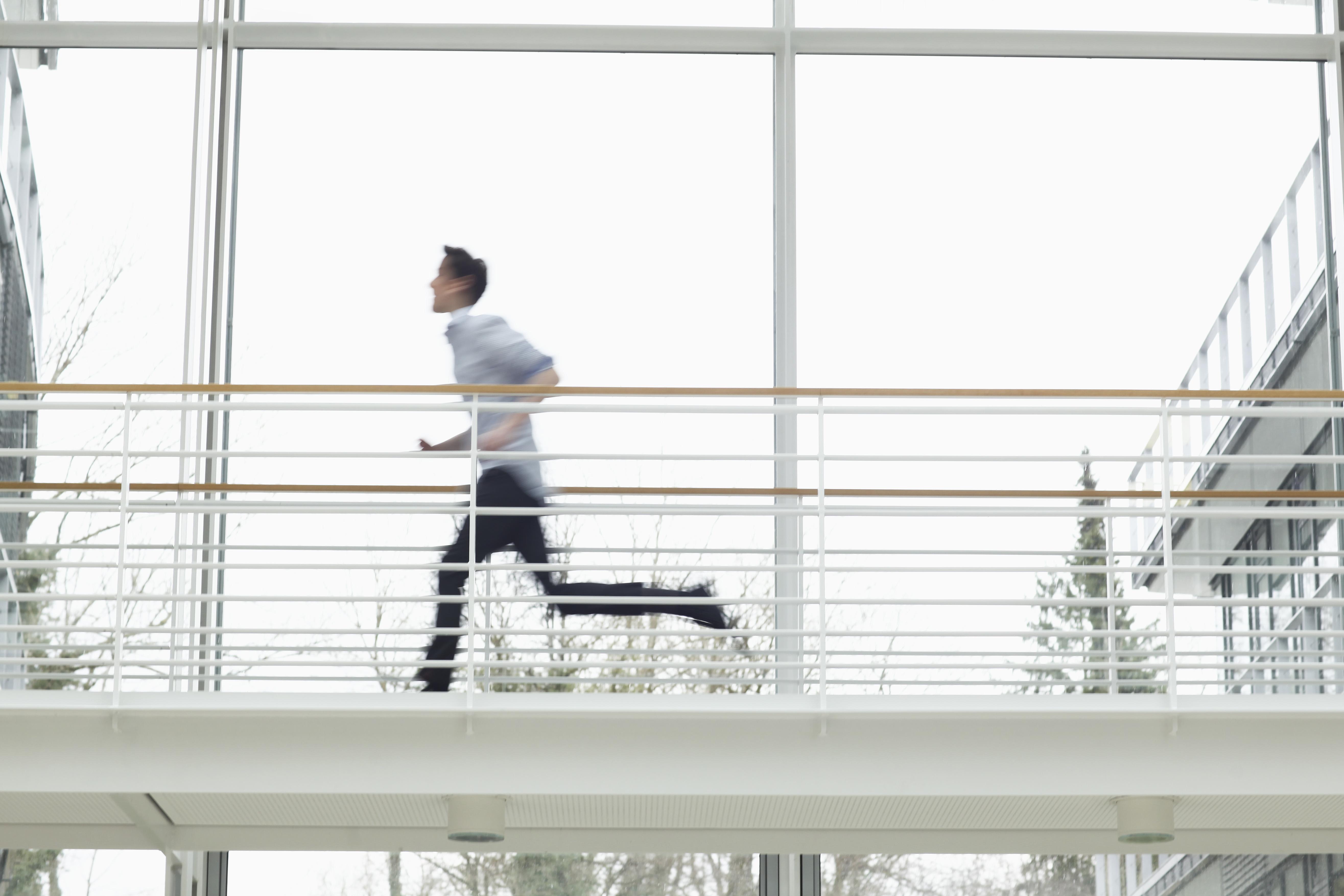 Teenage boy running on walkway