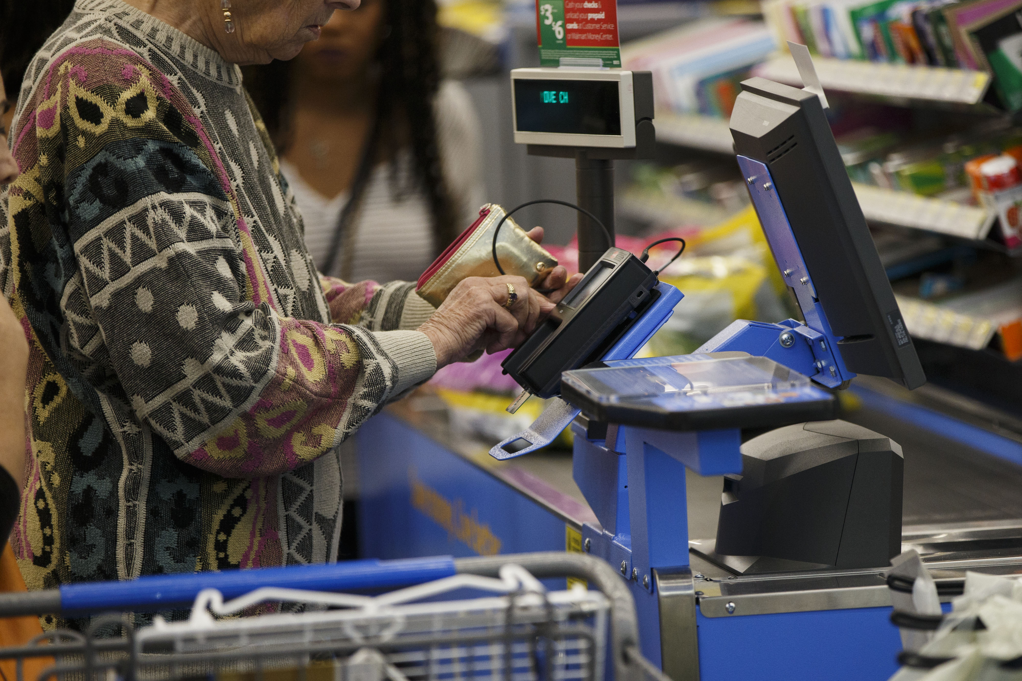 A customer uses a chip credit card terminal at a Wal-Mart Stores Inc. location in Burbank, California on Nov. 22, 2016.
