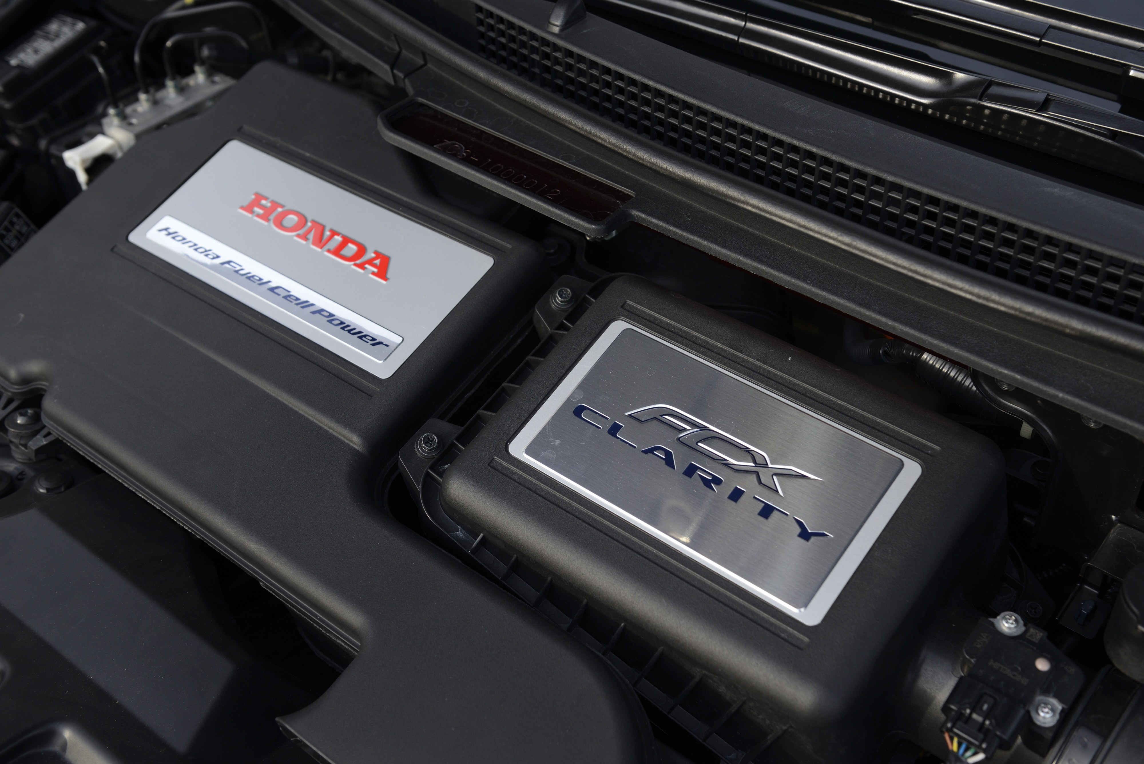 The Honda Motor logo is displayed on a FCX Clarity fuel cell vehicle (FCV) during the unveiling of the company's smart hydrogen fueling station in Japan on Thursday, Sept. 18, 2014.