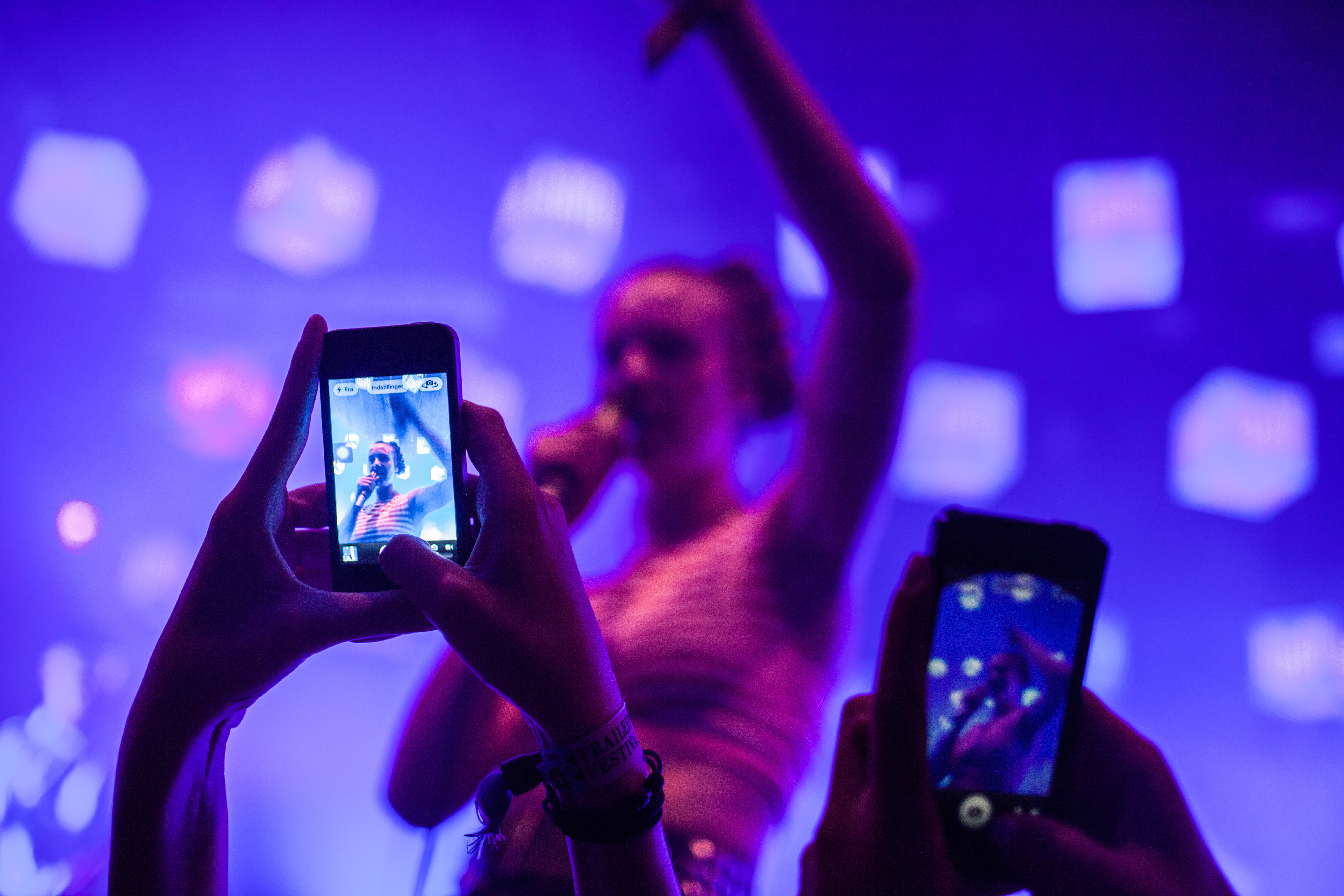 Concert guests take photos with their smart phones at a live concert. Denmark 2013.
