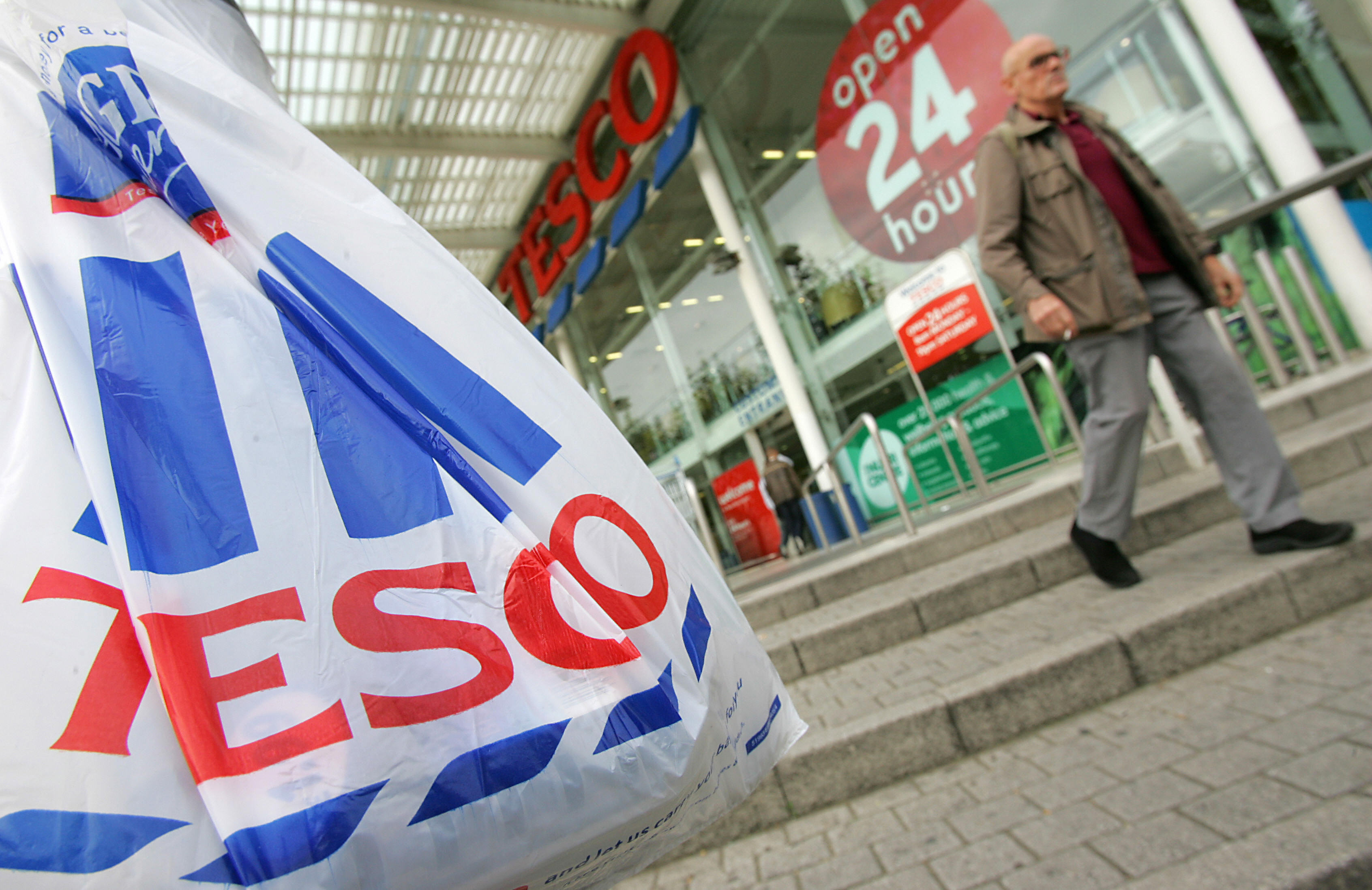 Customers leave a Tesco supermarket in w