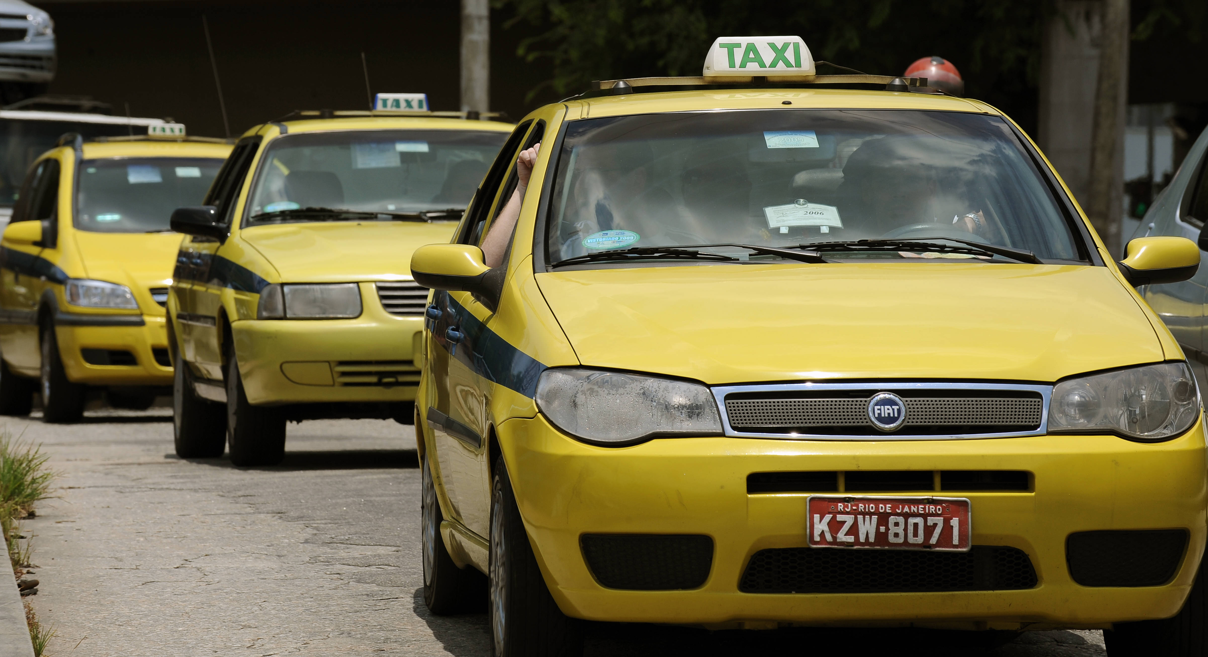Taxis drive in a street of Rio de Janeir