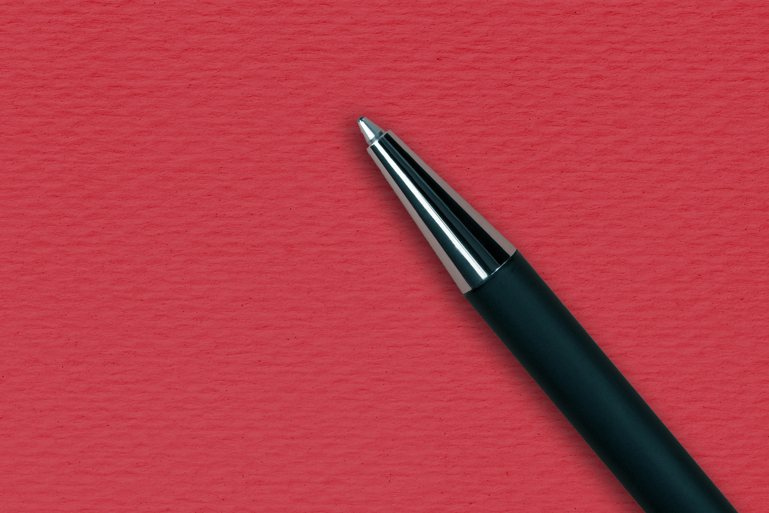 Black ball pen on the red papper background