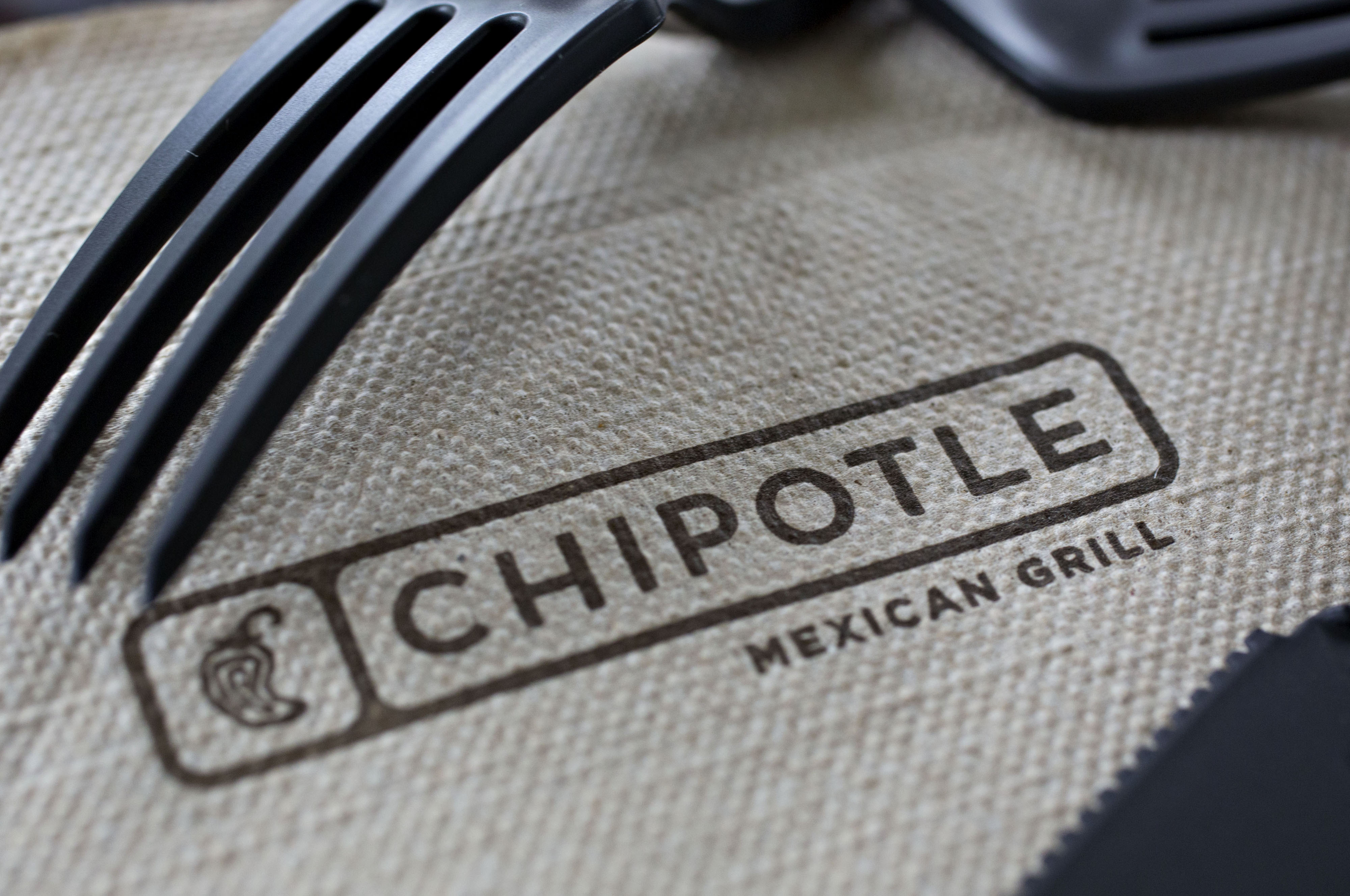Chipotle Mexican Grill Inc. signage is seen on a napkin arranged for a photograph in Tiskilwa, Illinois, U.S., on Friday, April 22, 2016.