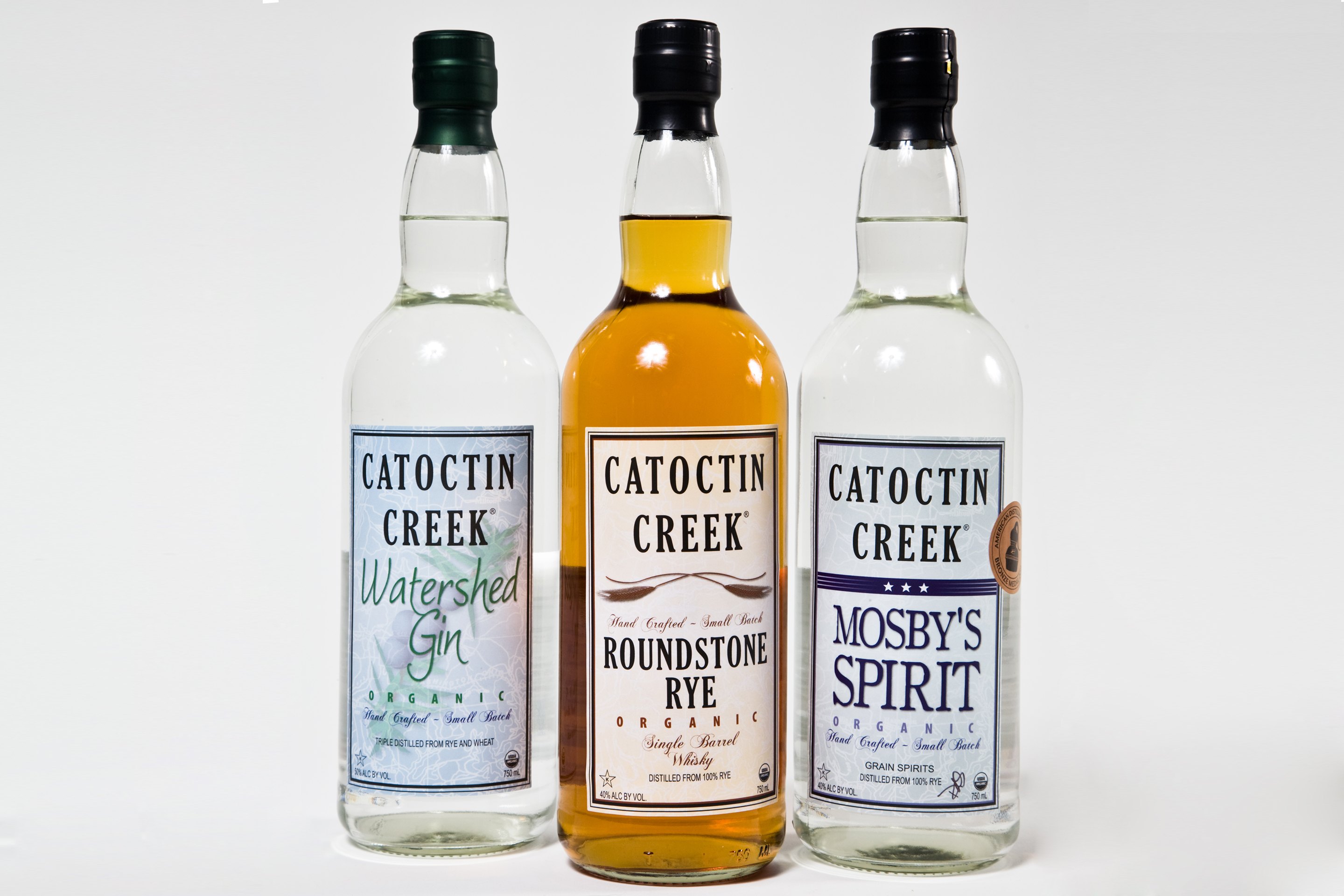 Bottles of Watershed Gin, Roundstone Rye Whisky and Mosby's Spirit at Catoctin Creek Distillery in Purcellville Virginia.