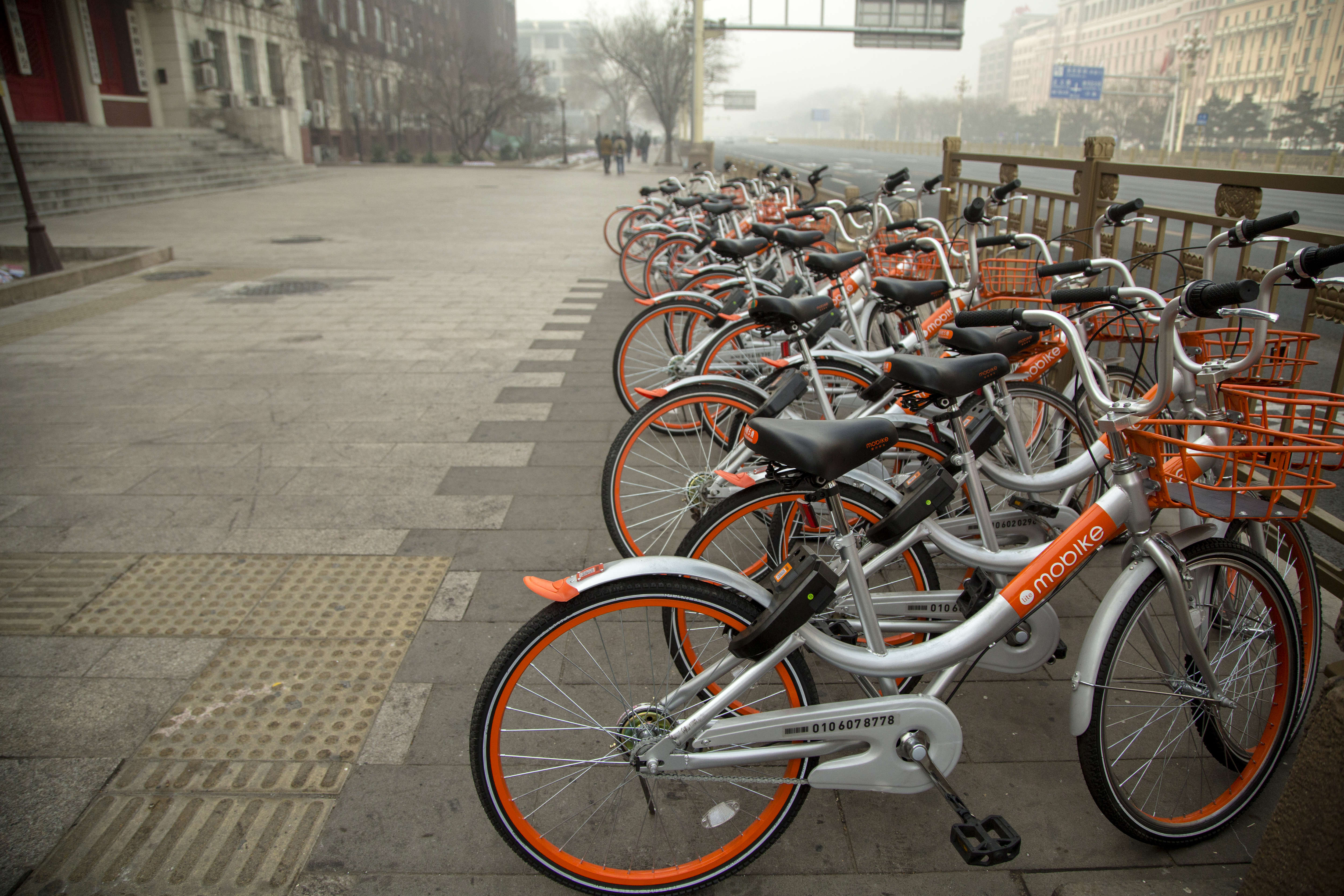 Mobikes bikes lined up on the streets.  Mobike is one of