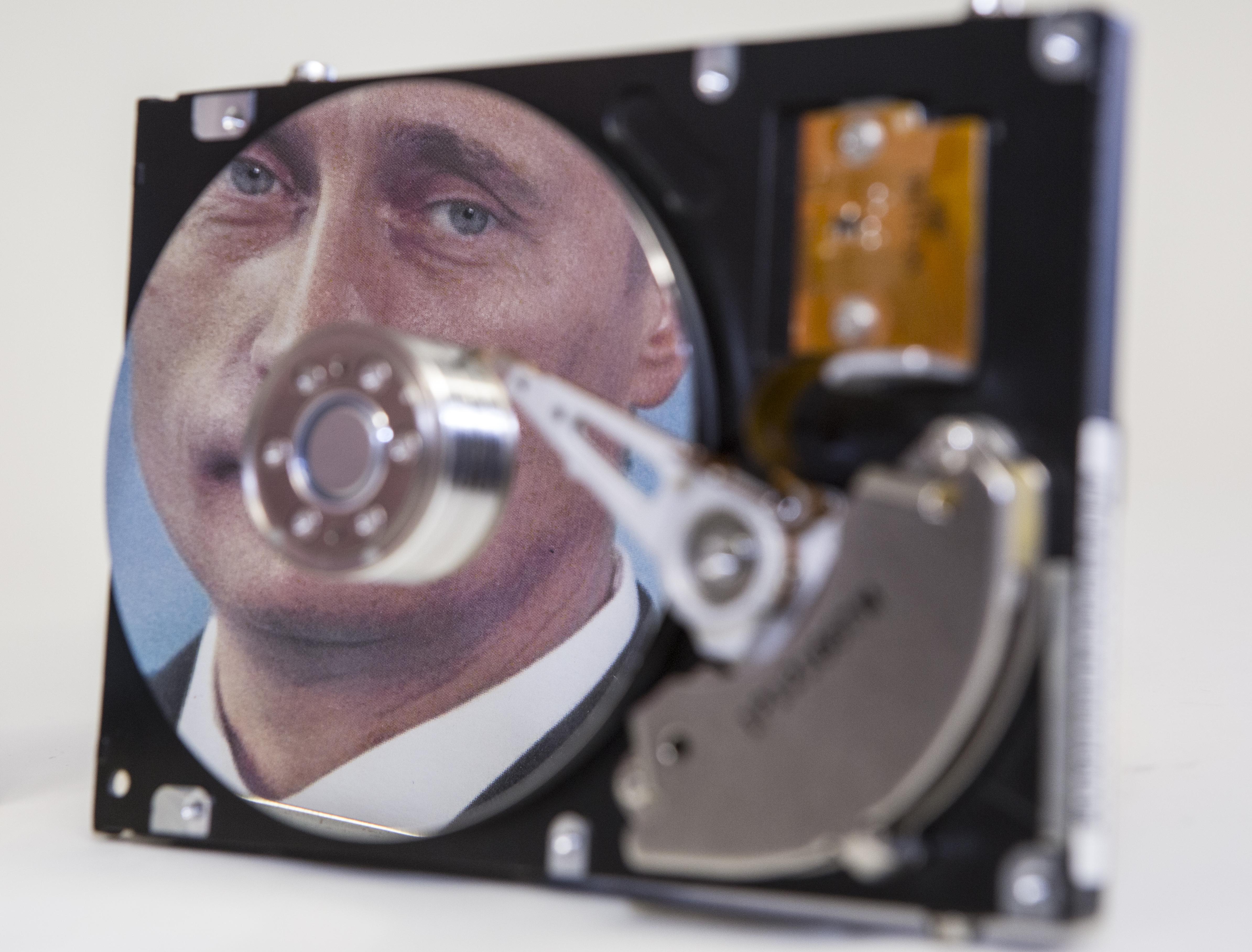 Putin-portrait reflected in a computer hard-drive.