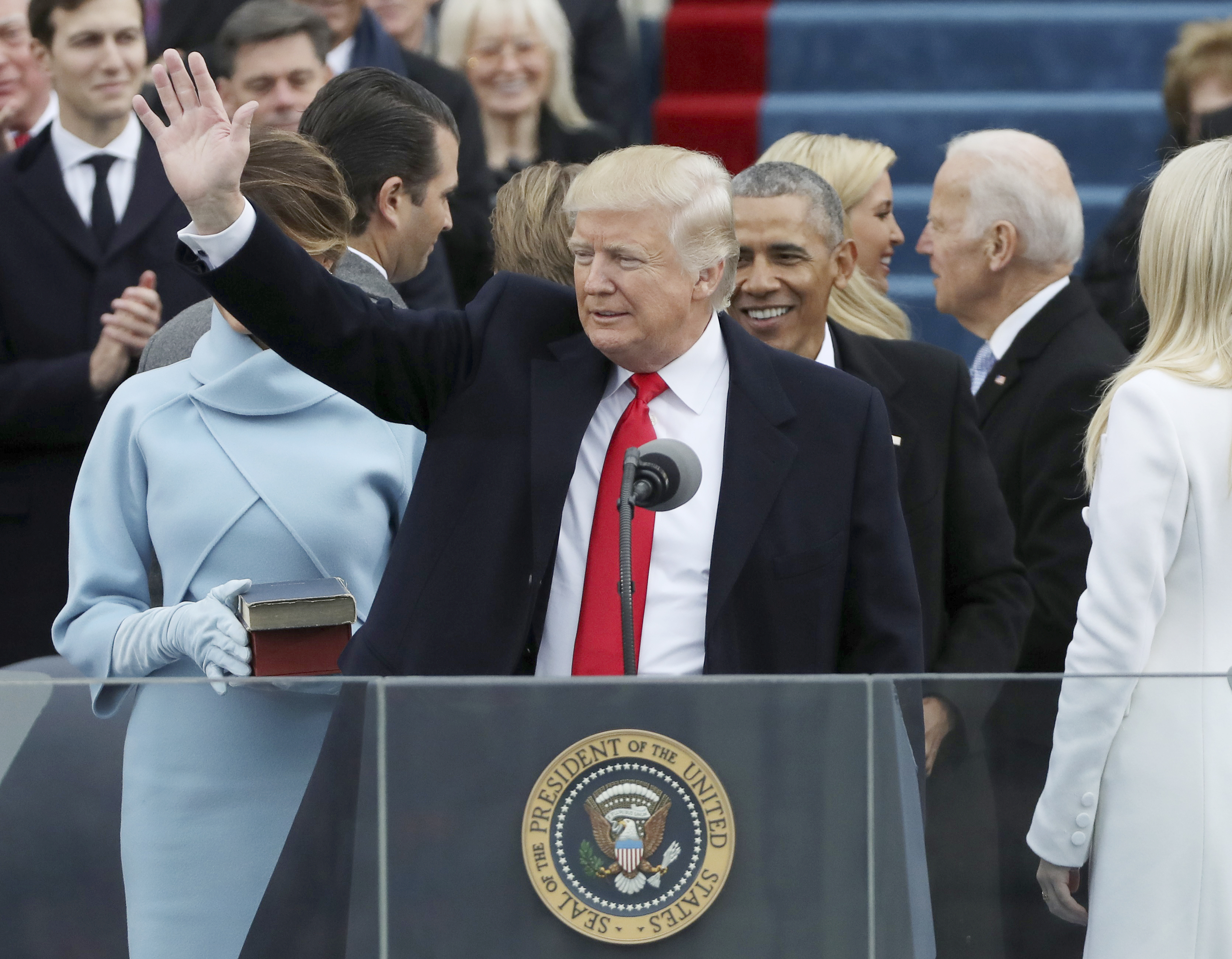 President Donald Trump waves after taking the oath at inauguration ceremonies swearing in Trump as the 45th president of the United States on the West front of the U.S. Capitol in Washington