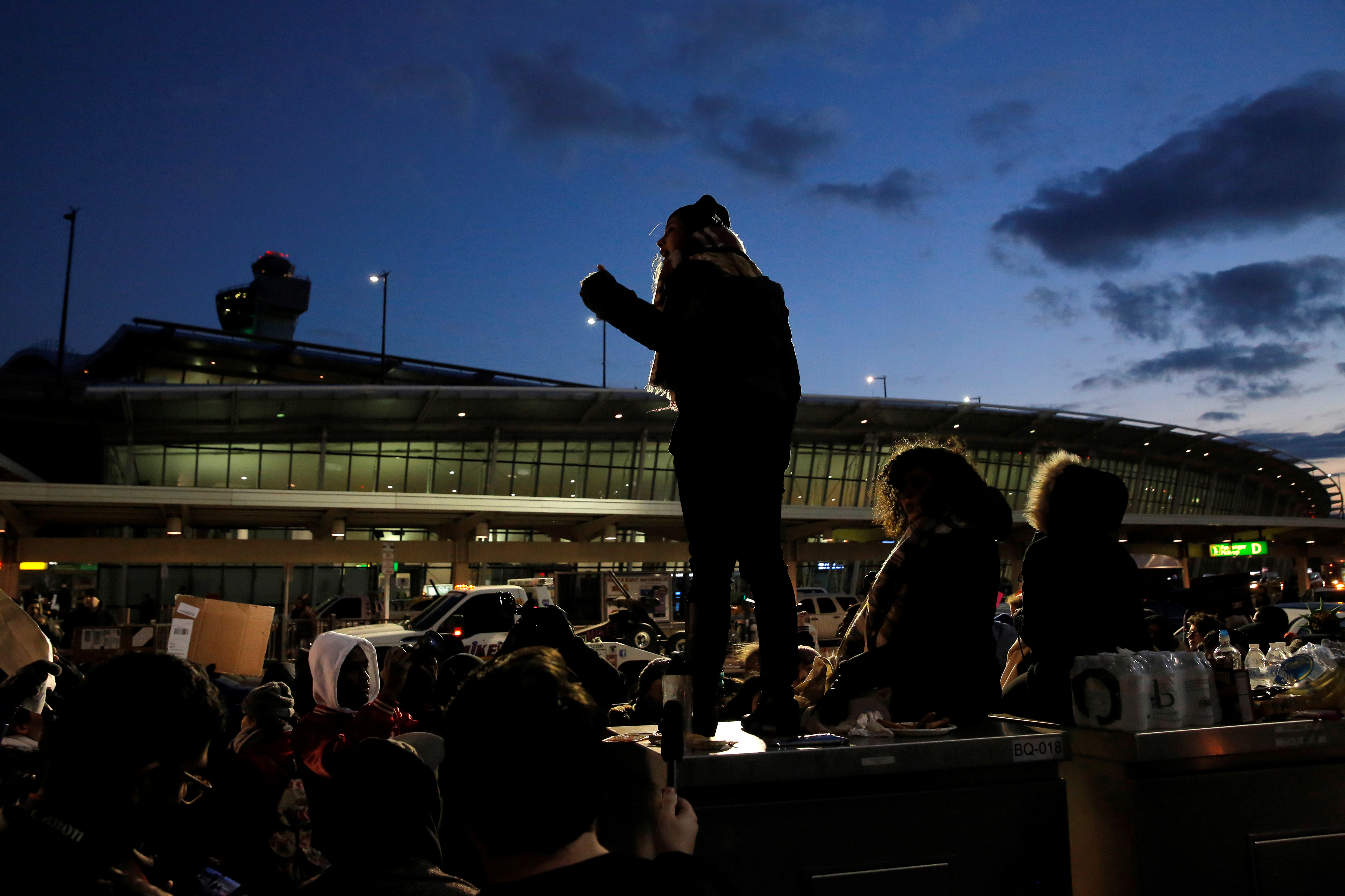 People gather at Terminal 4 during a protest against Donald Trump's travel ban at John F. Kennedy International Airport in Queens, New York, U.S.