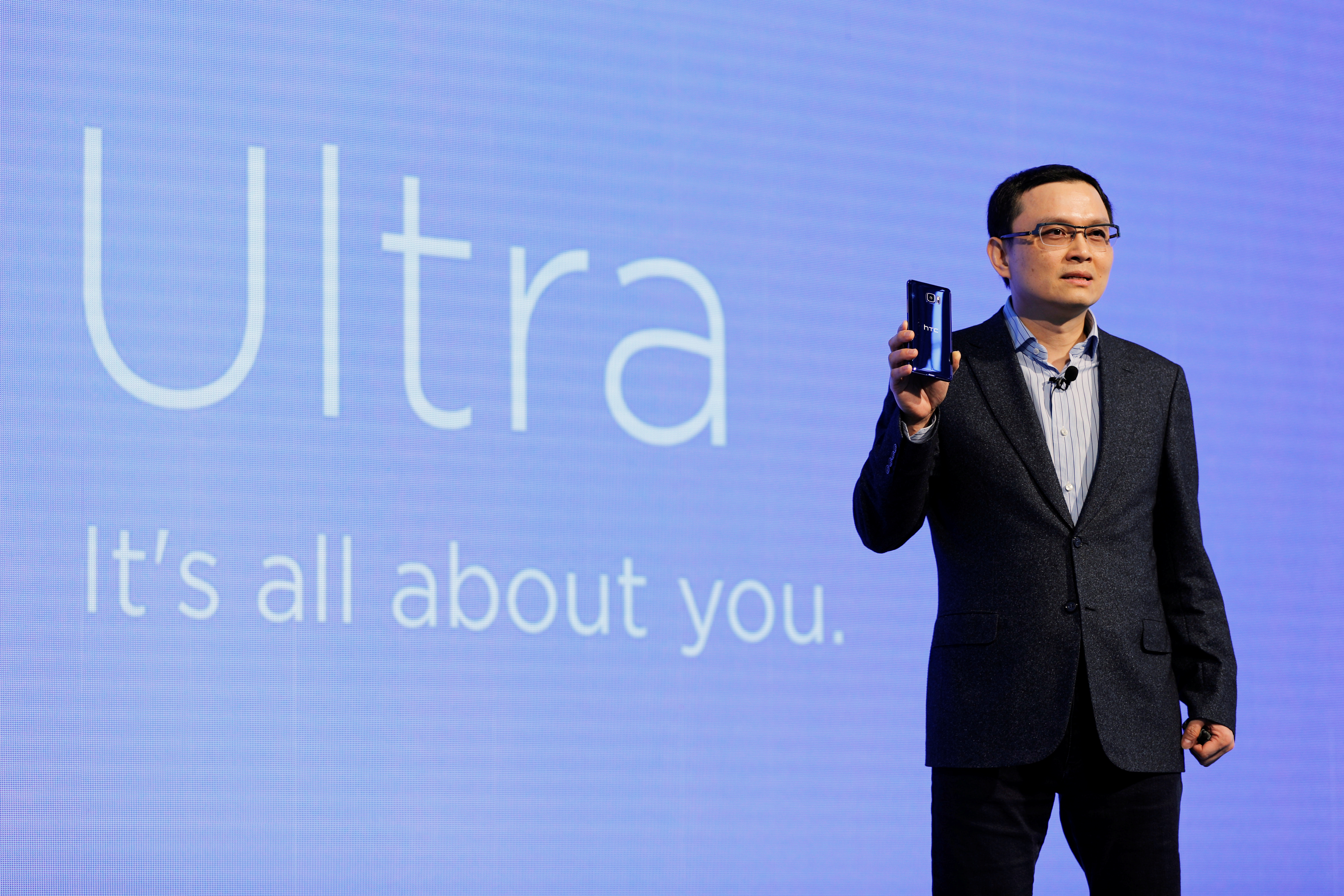 "Chang Chia-Lin, President of Global Sales of HTC speaks holding a new smartphone ""U Ultra"" during its launch event in Taipei"