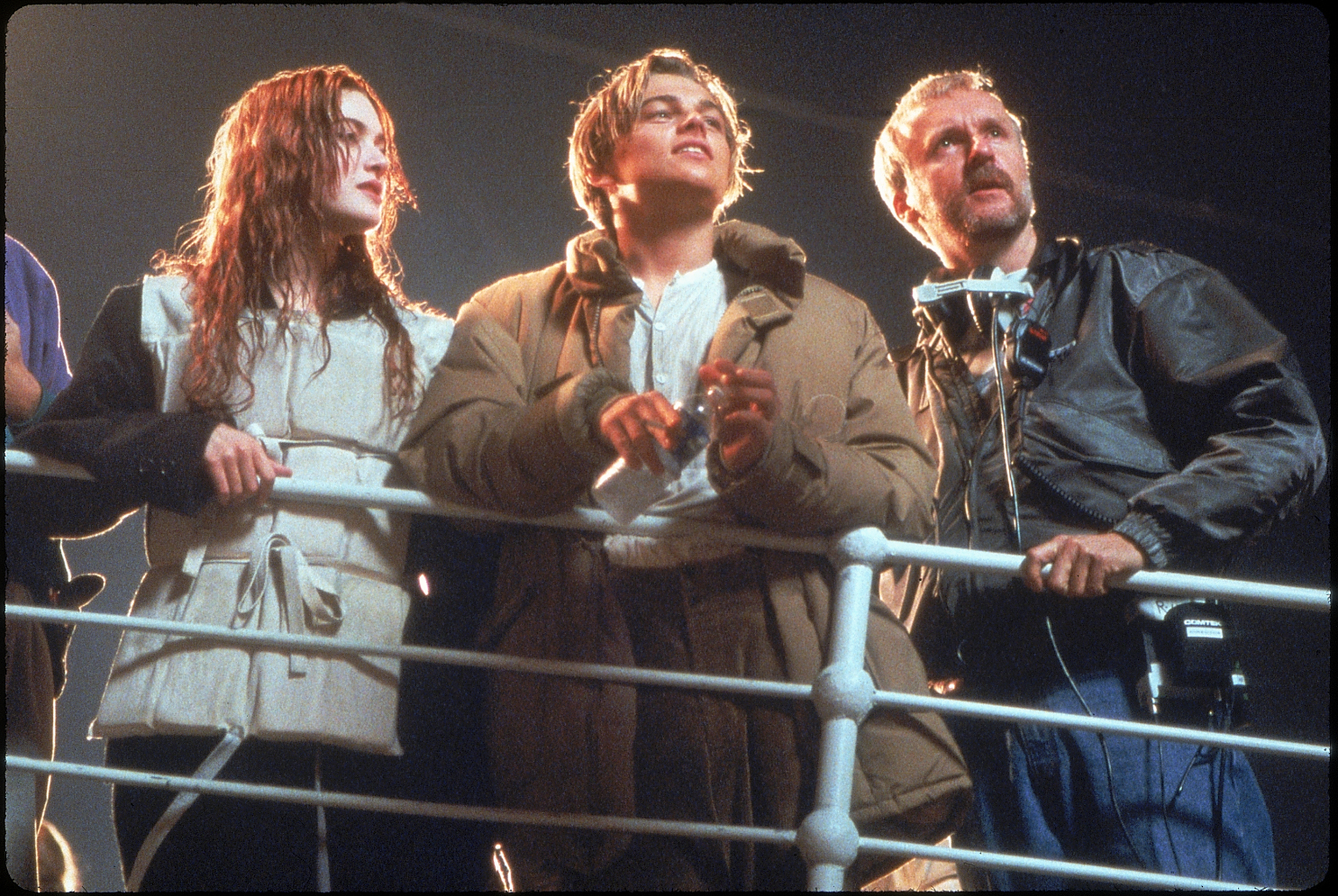 Kate Winslet, Leonardo DiCaprio and James Cameron on set while filming 'Titanic'.