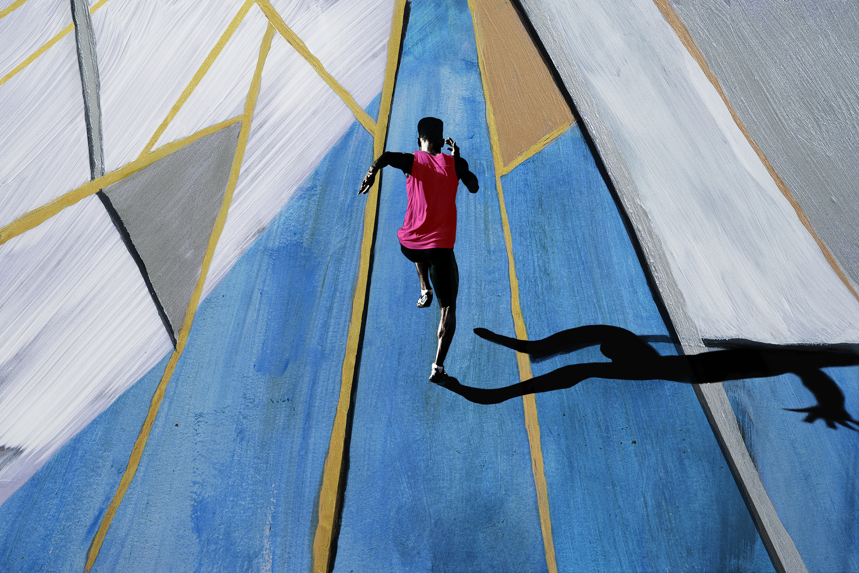 Male athlete sprinting, shot from above